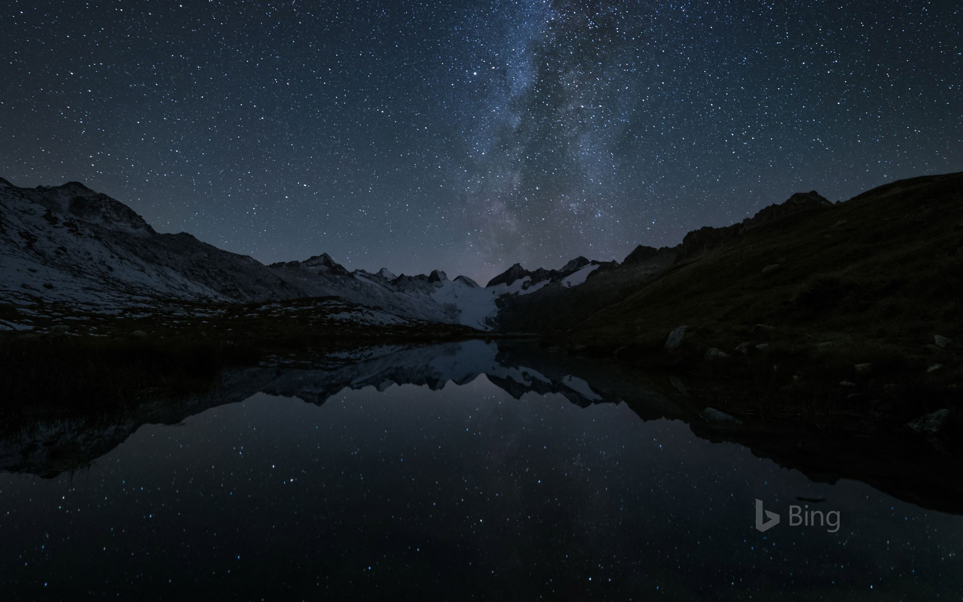 Stars reflected in the Totensee, a mountain lake at Grimsel Pass, Switzerland