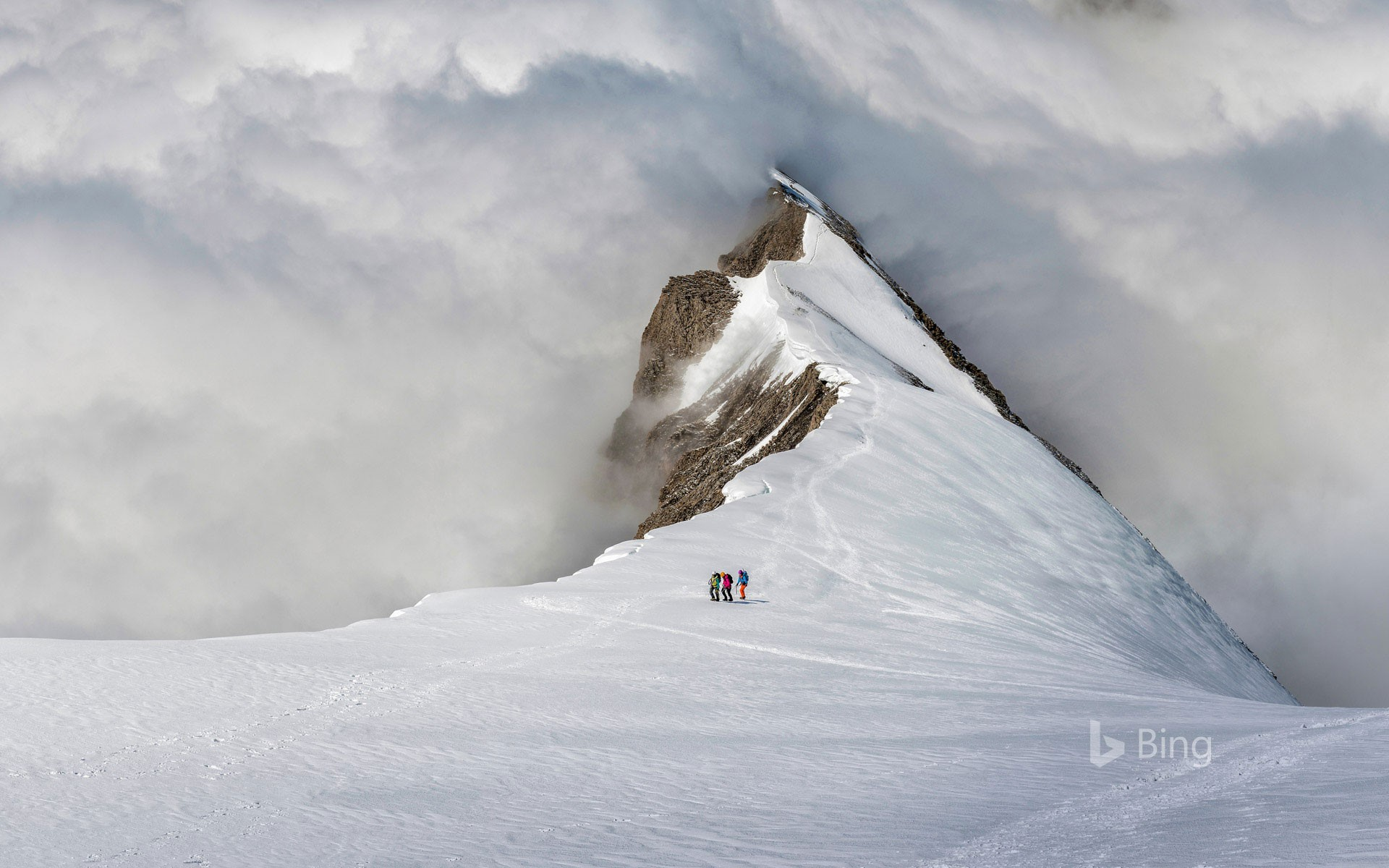 Mountaineers on the Balmhorn in the Bernese Alps of Switzerland
