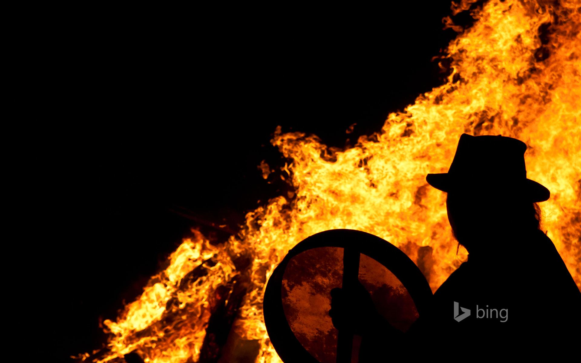 Drummer with a bodhran at a pagan Beltane fire ceremony