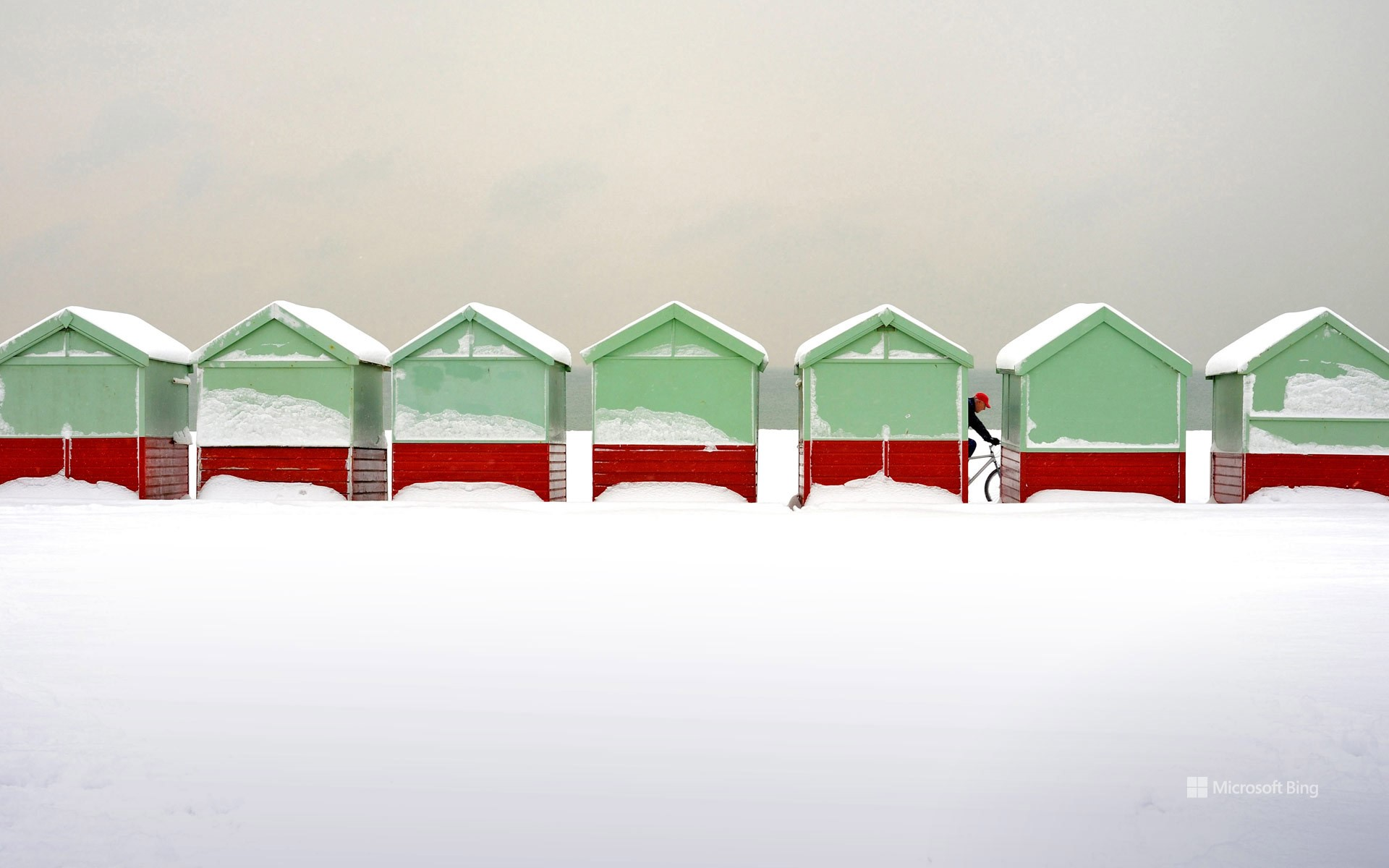 Beach huts covered in snow in Brighton and Hove, England