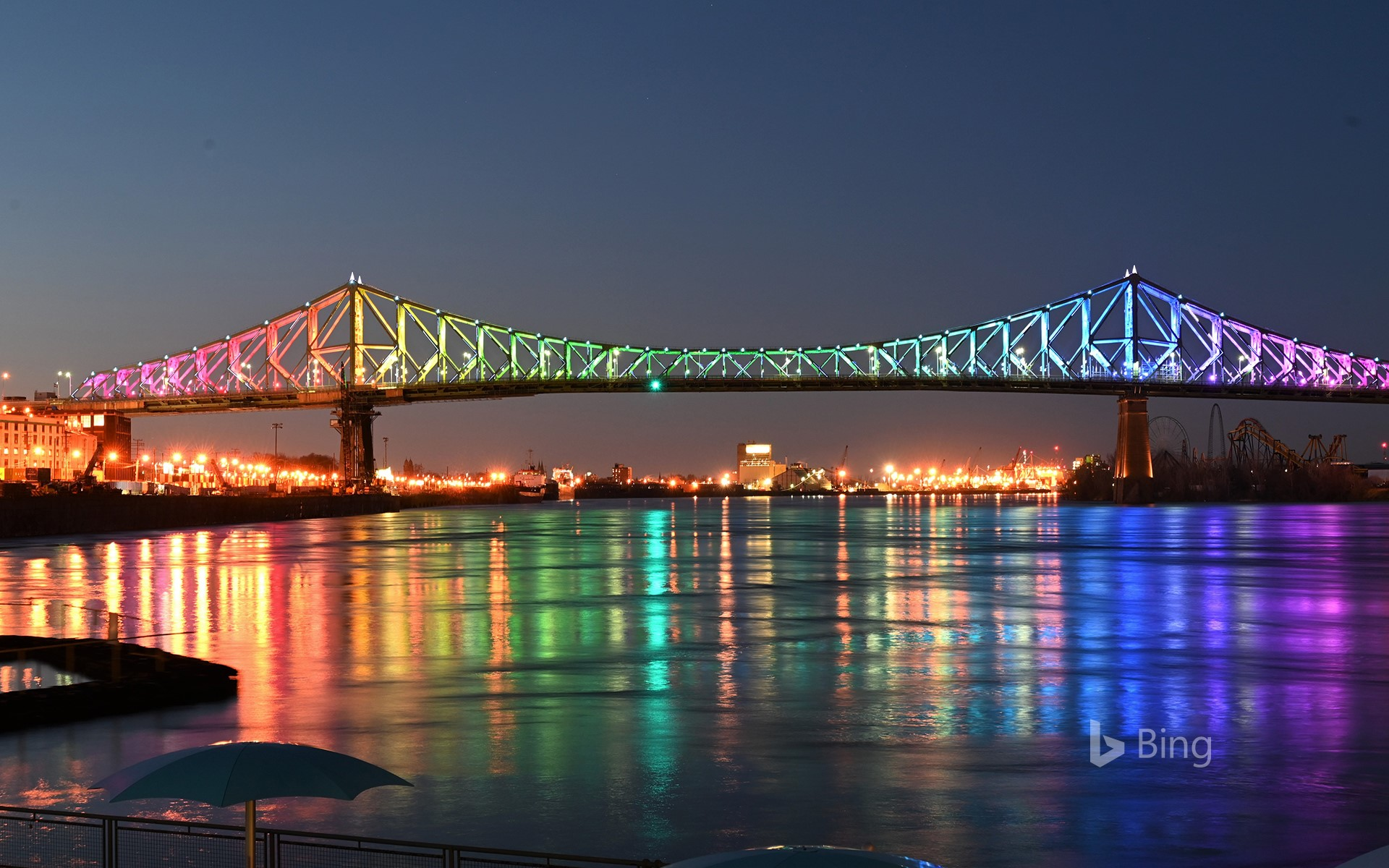 The Jacques Cartier bridge in Montreal is illuminated in the colours of the rainbow as a sign of hope and in support of the victims of the coronavirus