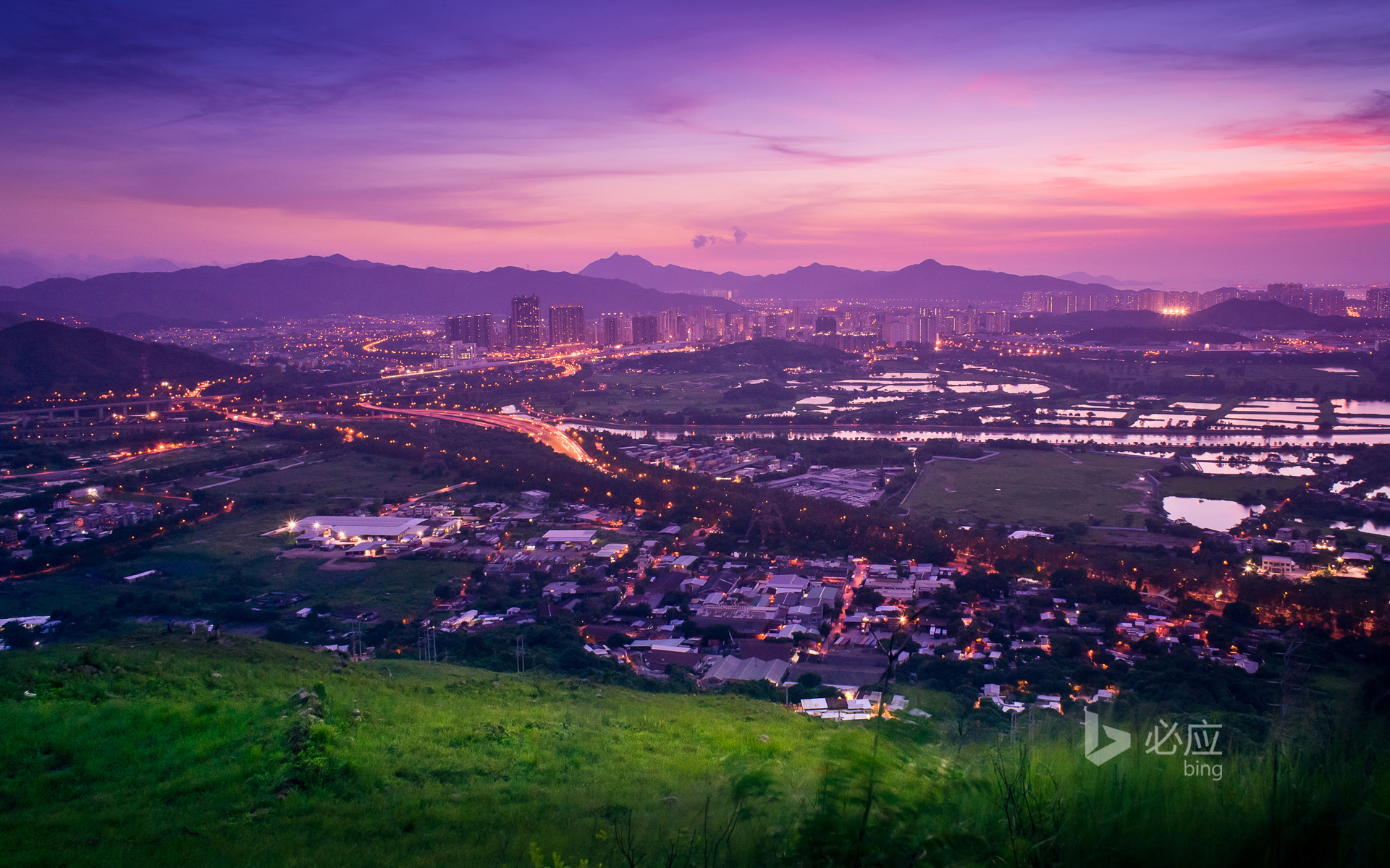 Enjoy the scenery of Yuen Long from a hill in Hong Kong at sunset