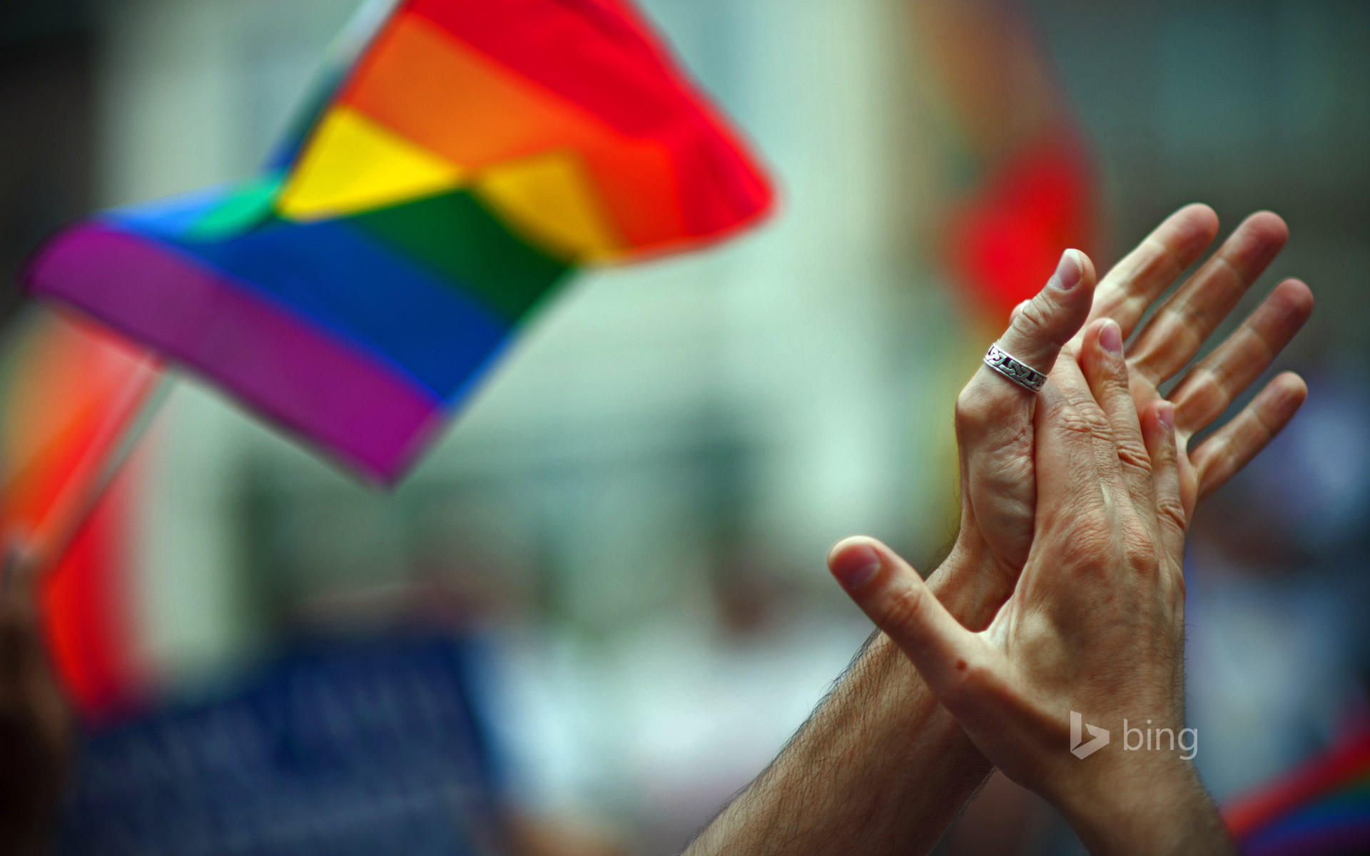 Rainbow flag and clapping hands