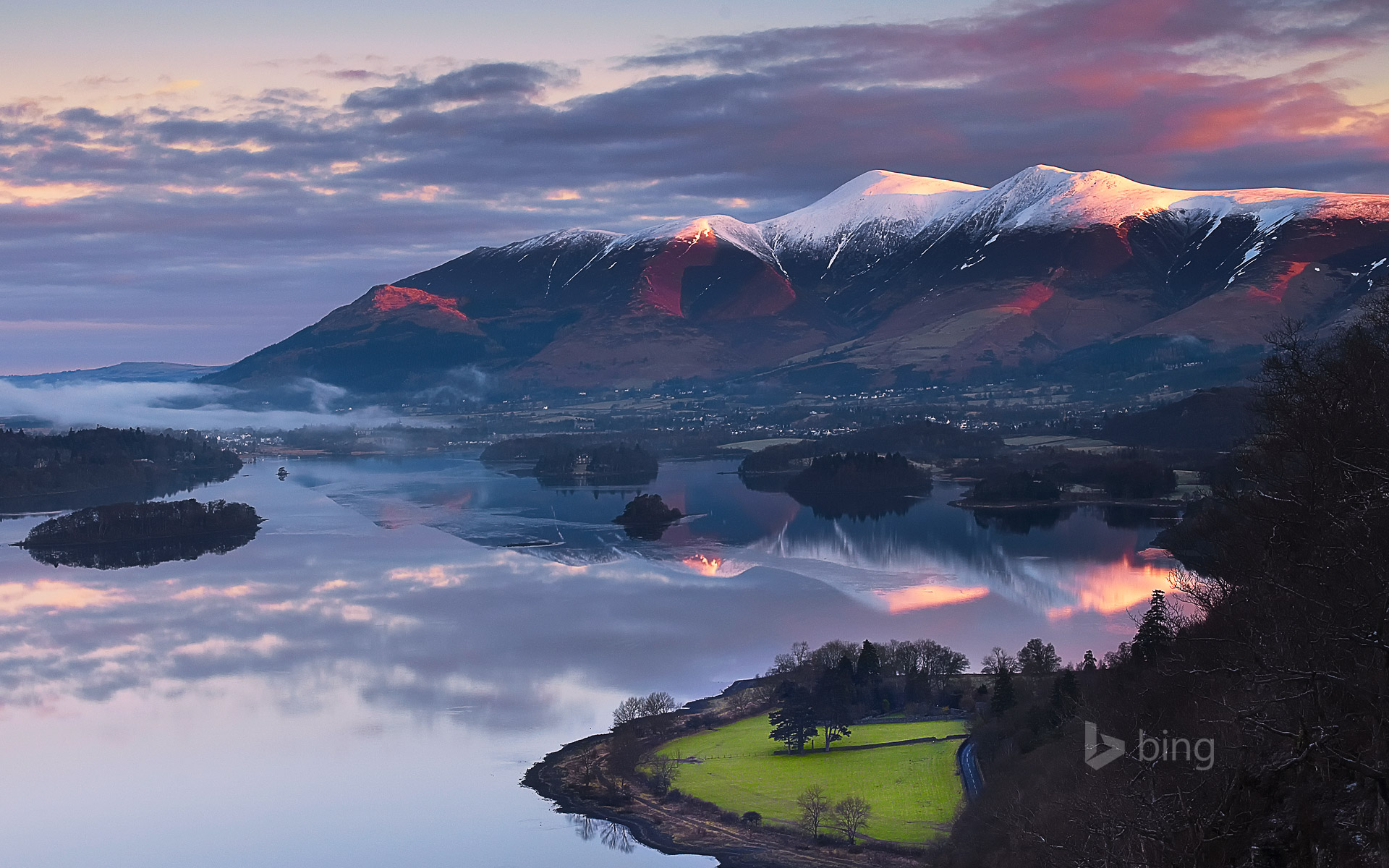 Sun rising over Skiddaw Mountain and Derwentwater in Cumbria, England