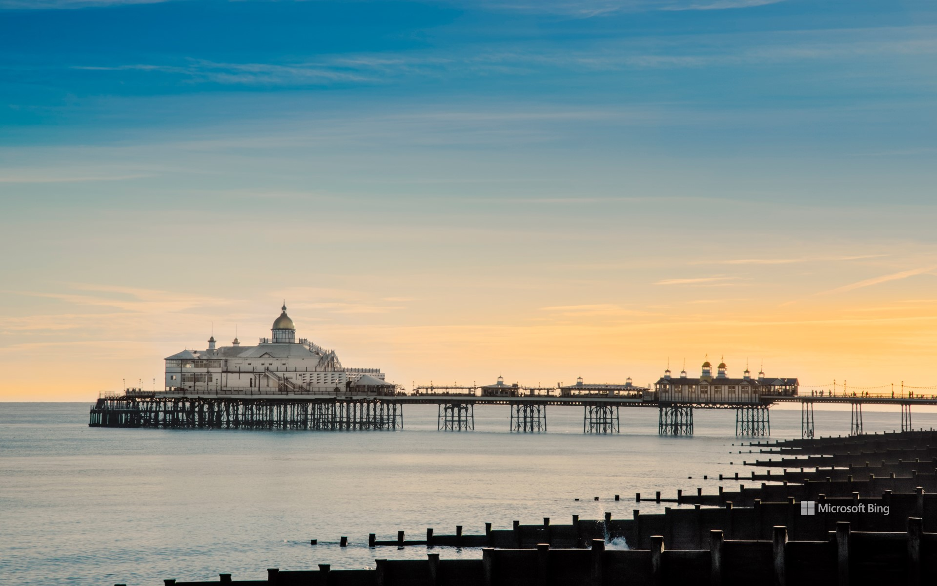 View along the beach to Eastbourne Pier, Eastbourne, East Sussex.