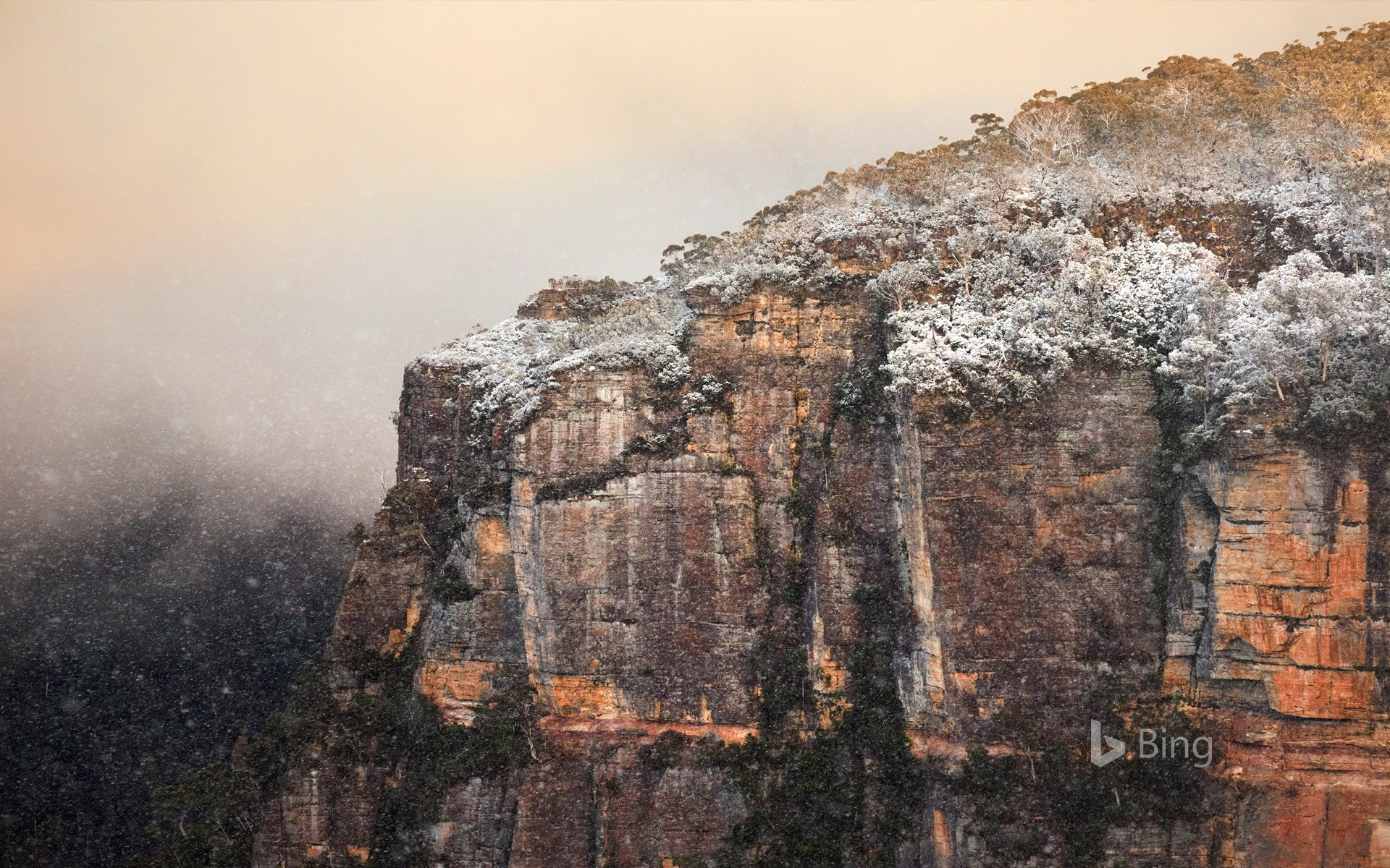 A snow-covered rocky cliff at Echo Point lookout, Katoomba, New South Wales