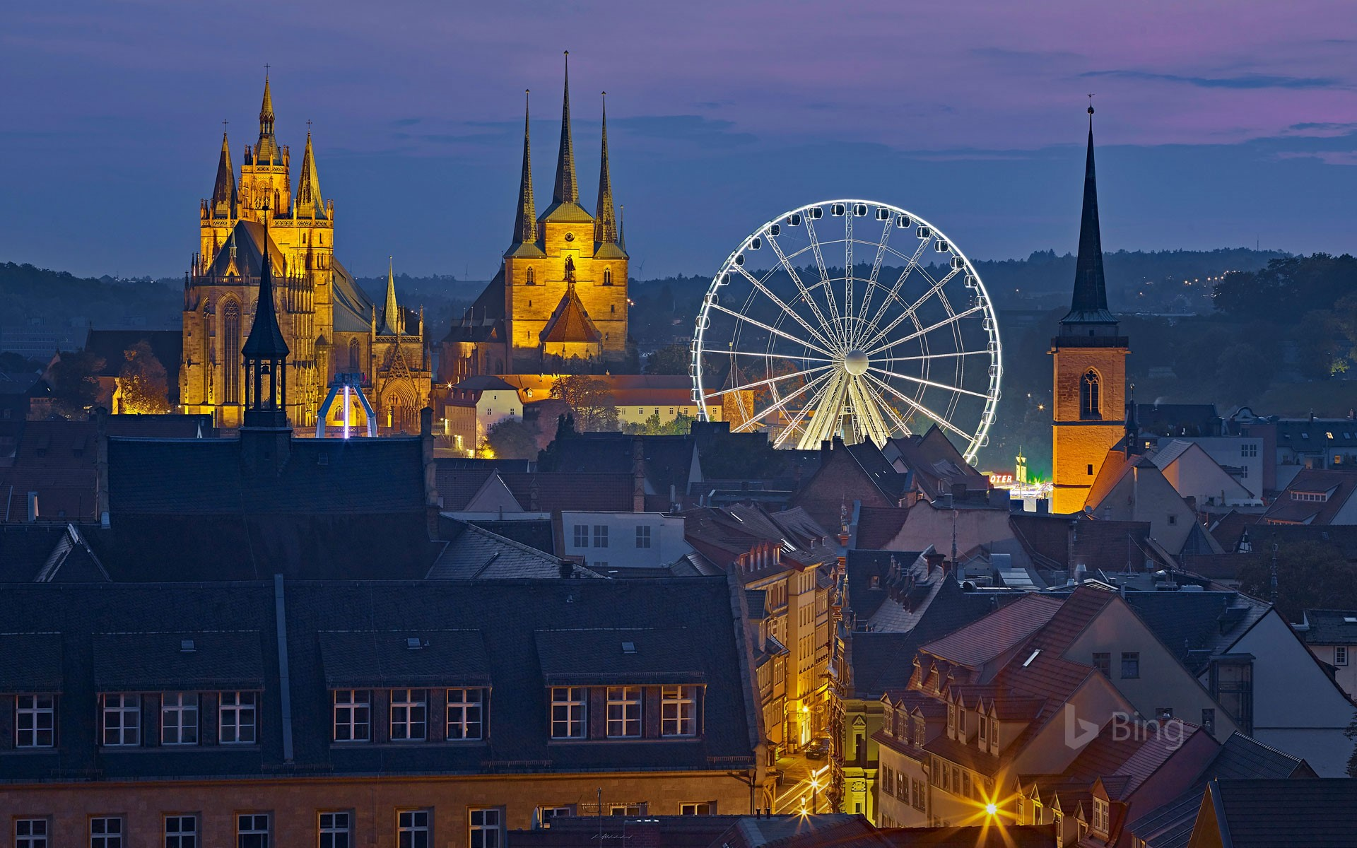 View of the Ferris wheel, Erfurt Cathedral and St. Severus Church during Oktoberfest in Erfurt, Germany