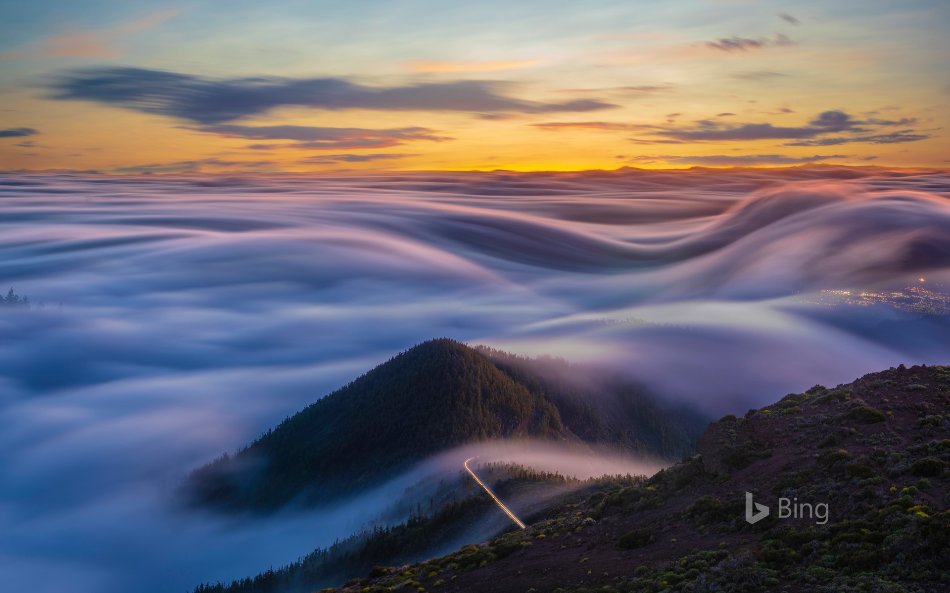 Clouds flowing over the mountains of Tenerife, Canary Islands, Spain