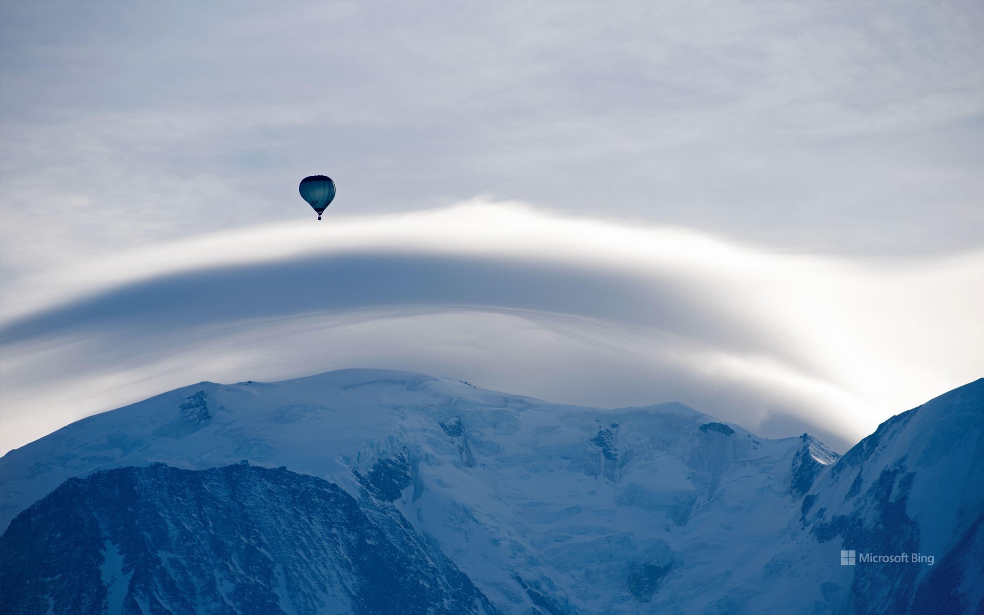 Mont Blanc, topped by a lenticular cloud and a hot air balloon, Haute-Savoie