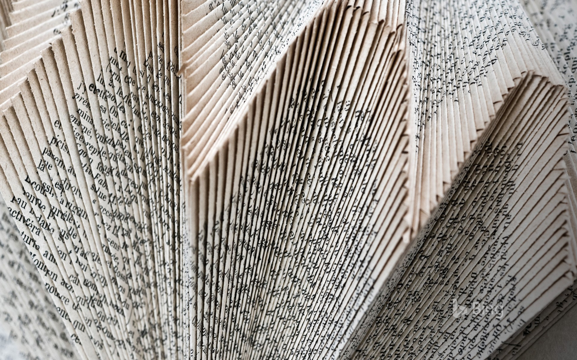 Decorative structure of folded book pages, Angles-sur-l'Anglin, Vienne