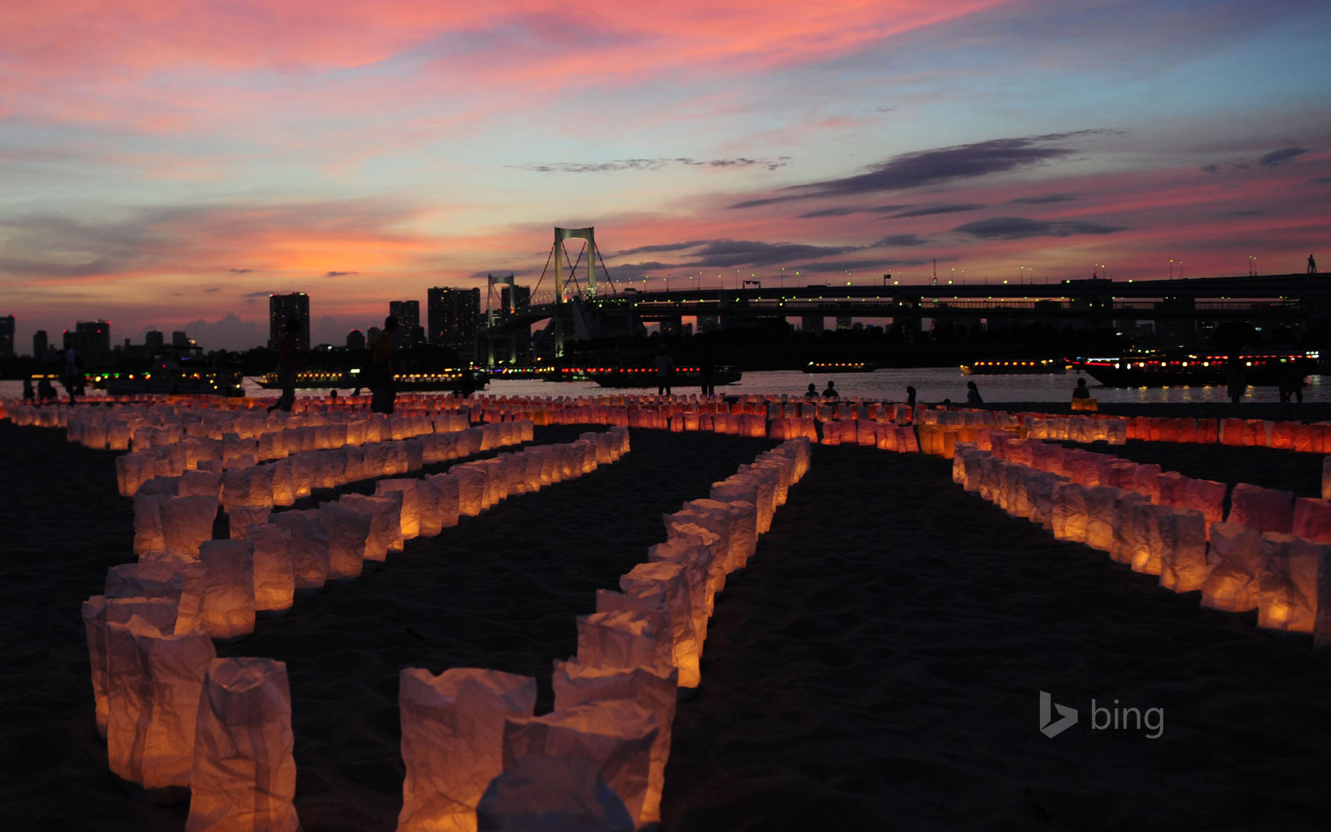 Candles line the beach at Odaiba Marine Park for Marine Day, Tokyo, Japan