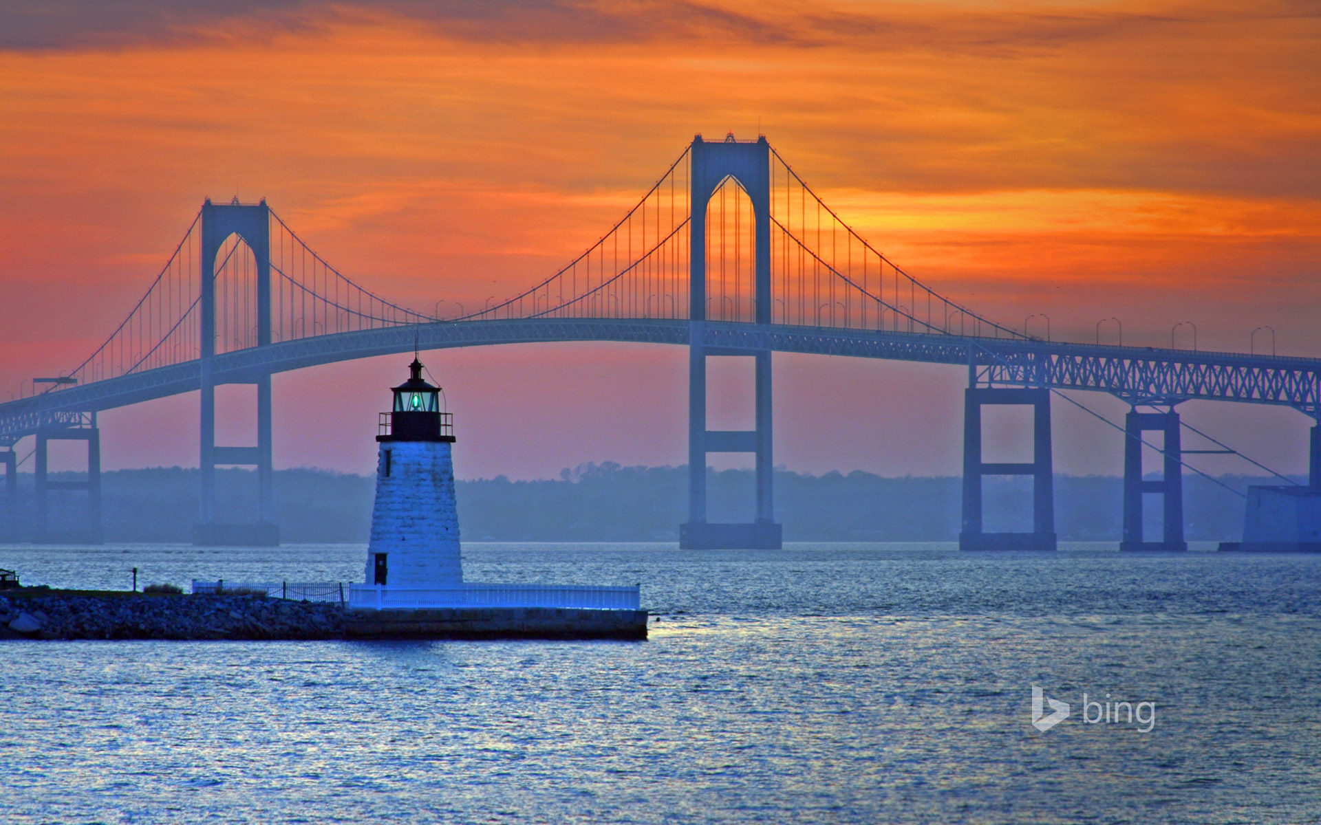 Claiborne Pell Newport Bridge and Newport Harbor Light in Newport, Rhode Island