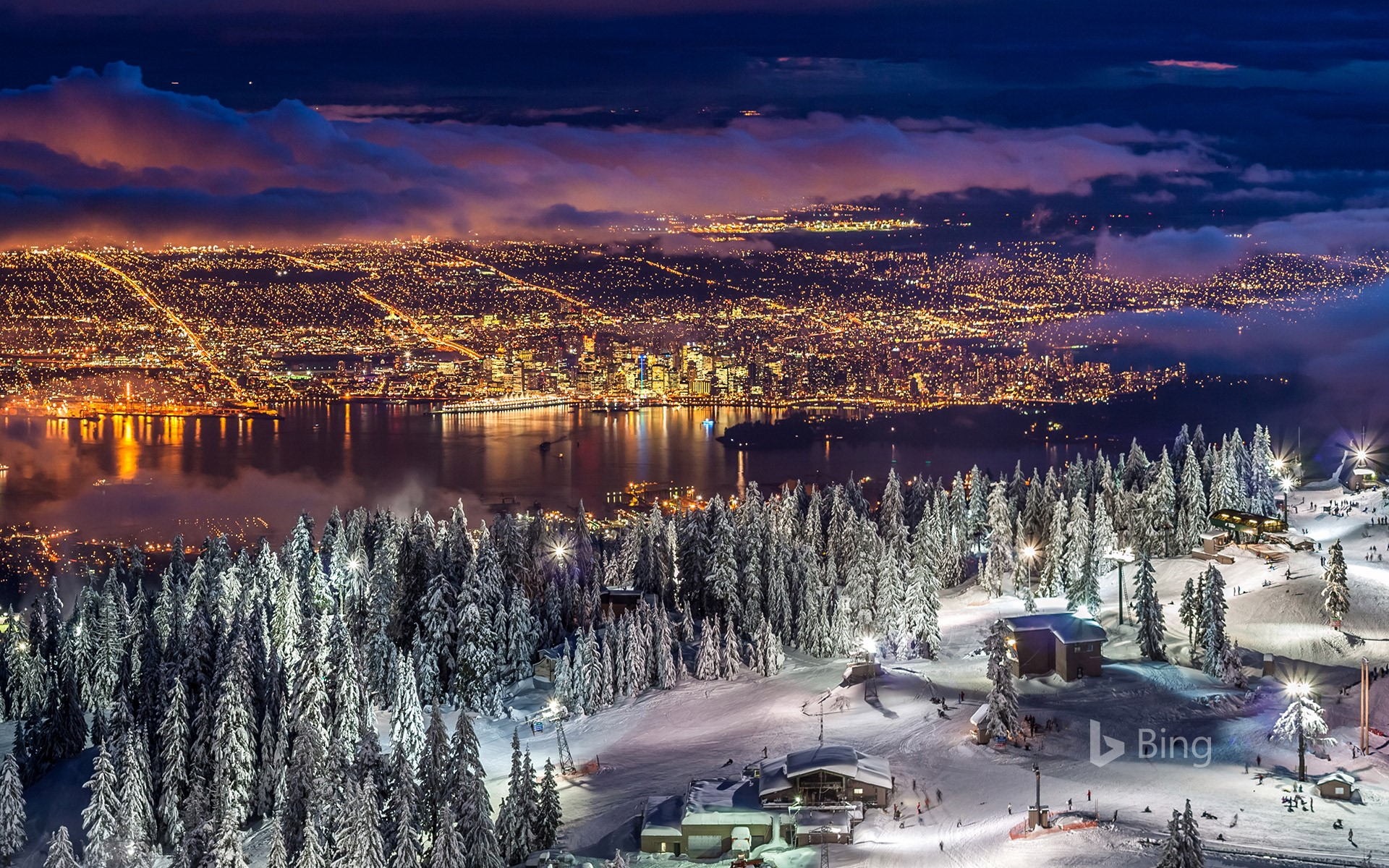 City lights from the snowy peak of Grouse Mountain at twilight, Vancouver, BC, Canada