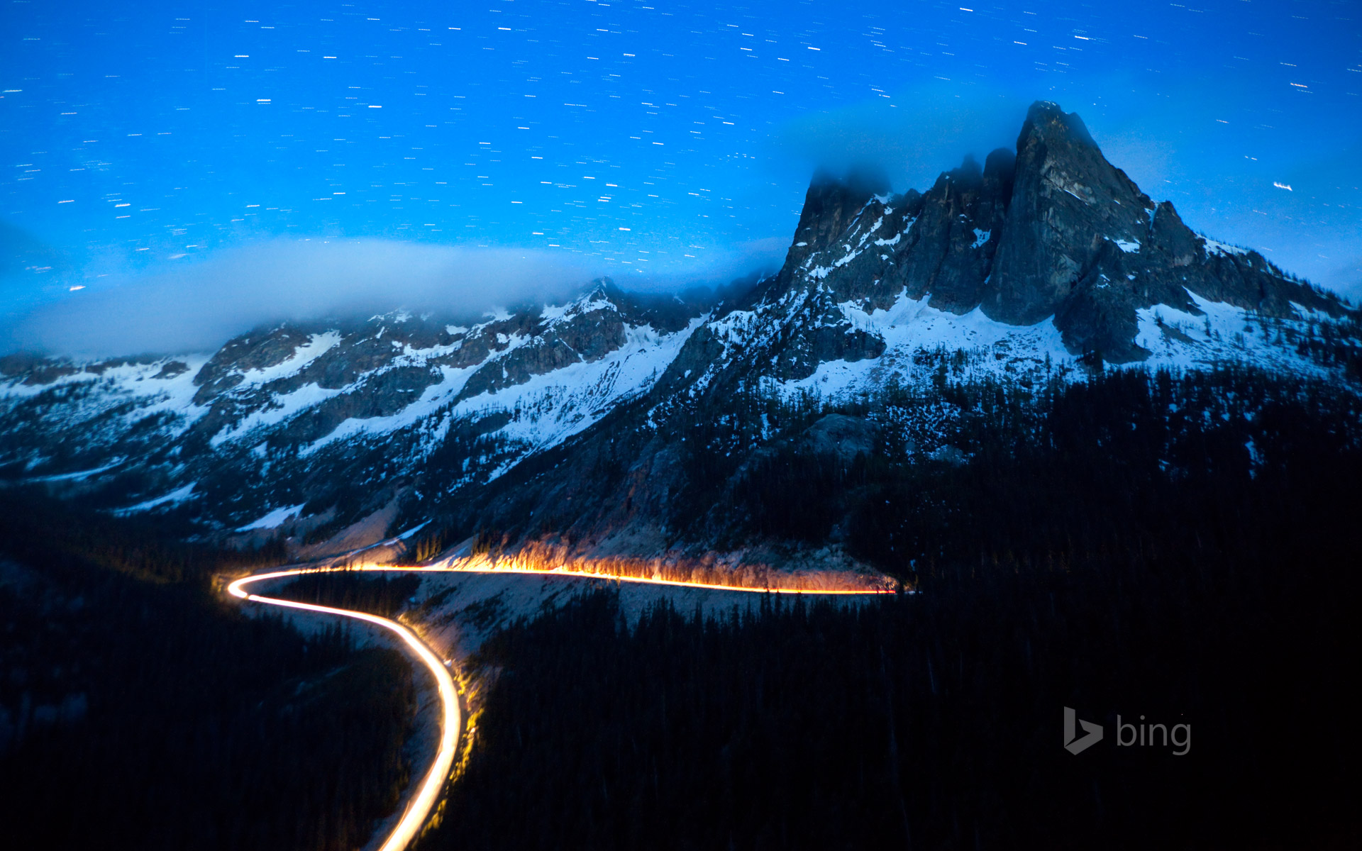 Headlights on State Route 20, the North Cascades Scenic Highway, Washington