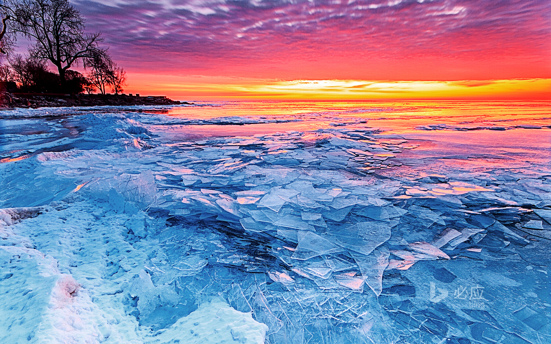 Ice and fire, rising sun over frozen Lake Erie