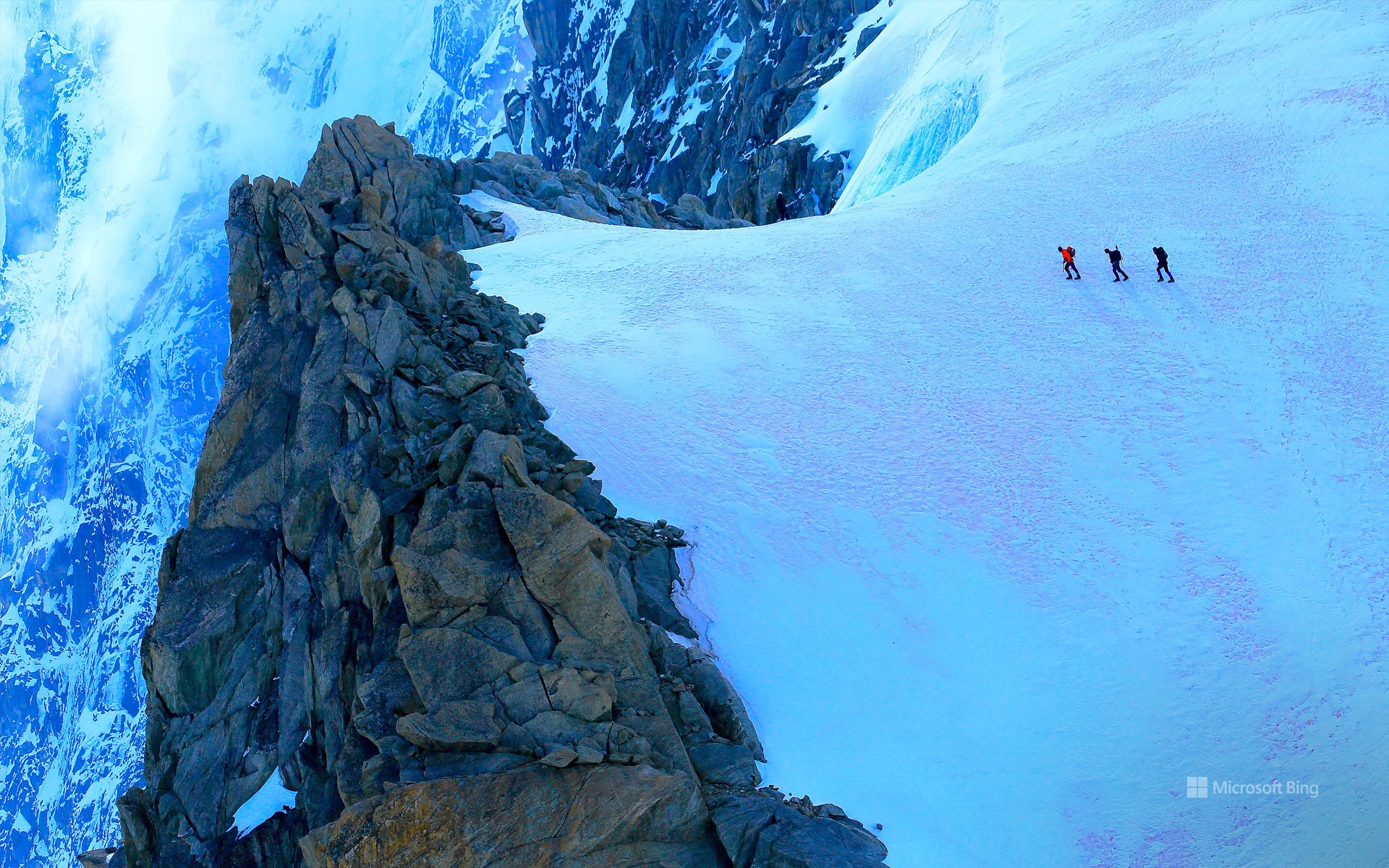 Hikers on alpine glacier, Mont Blanc, Chamonix, France