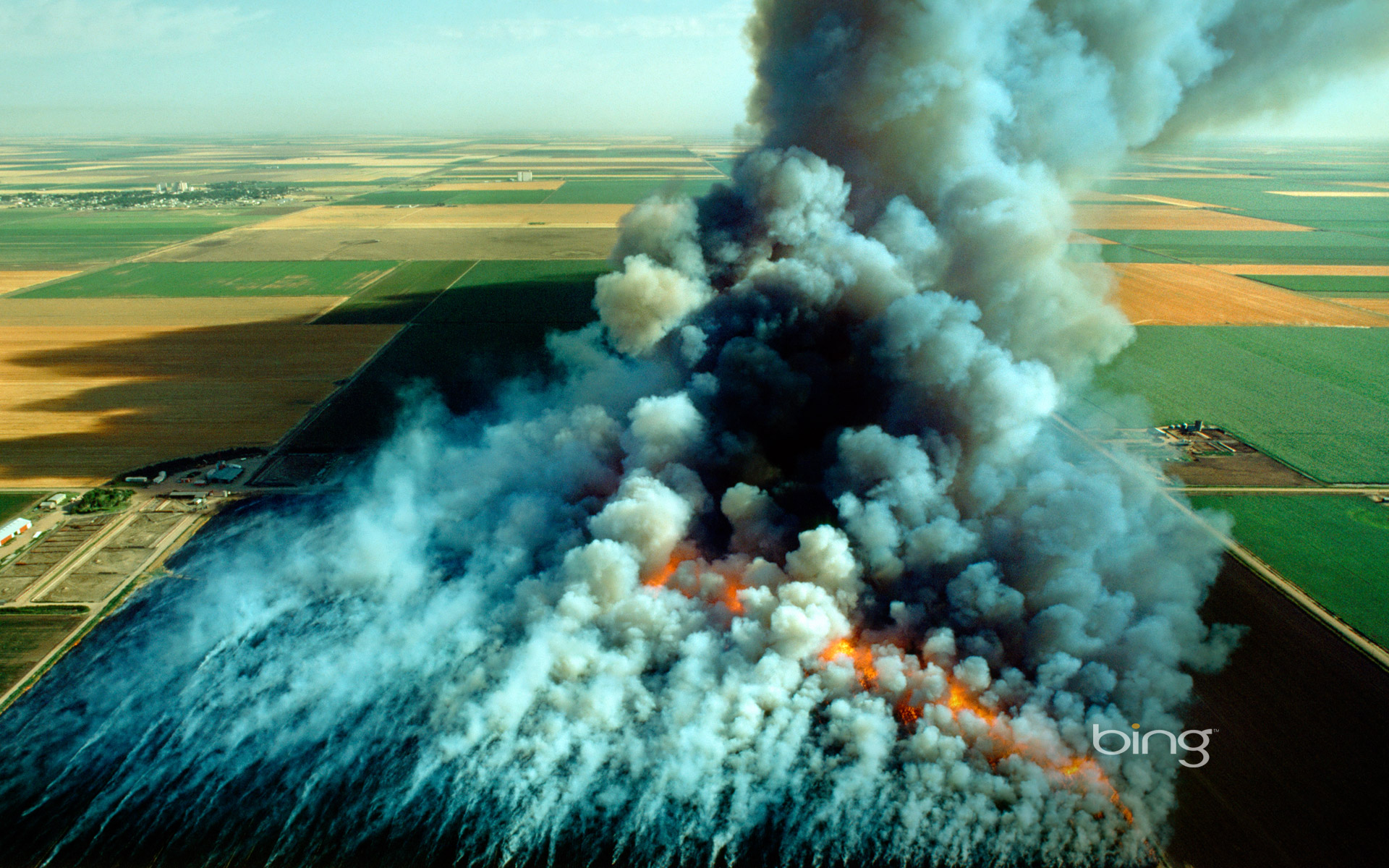 Aerial view, wheat field stubble burn, Kansas