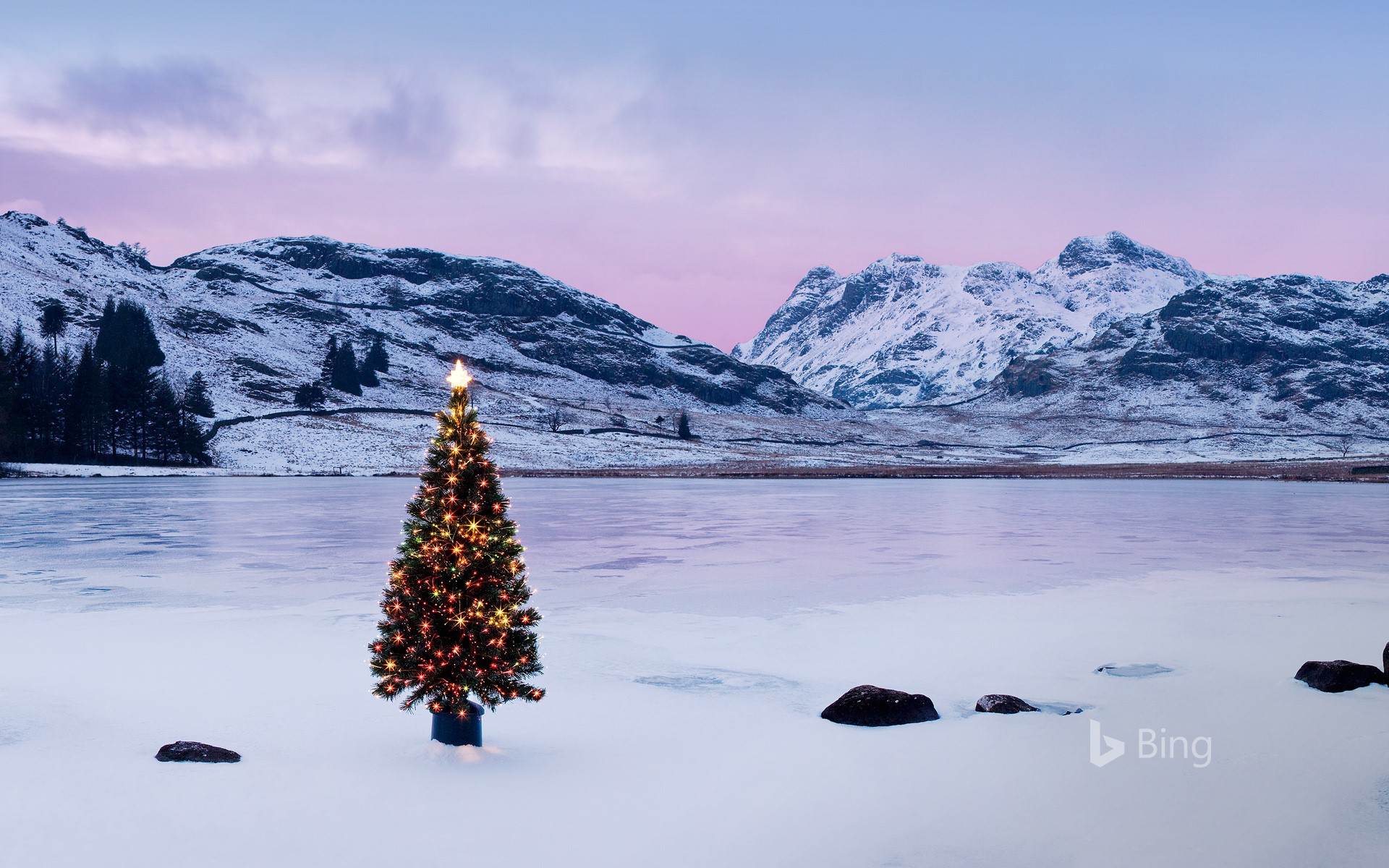 The Langdale Pikes with an illuminated Christmas tree, Lake District National Park