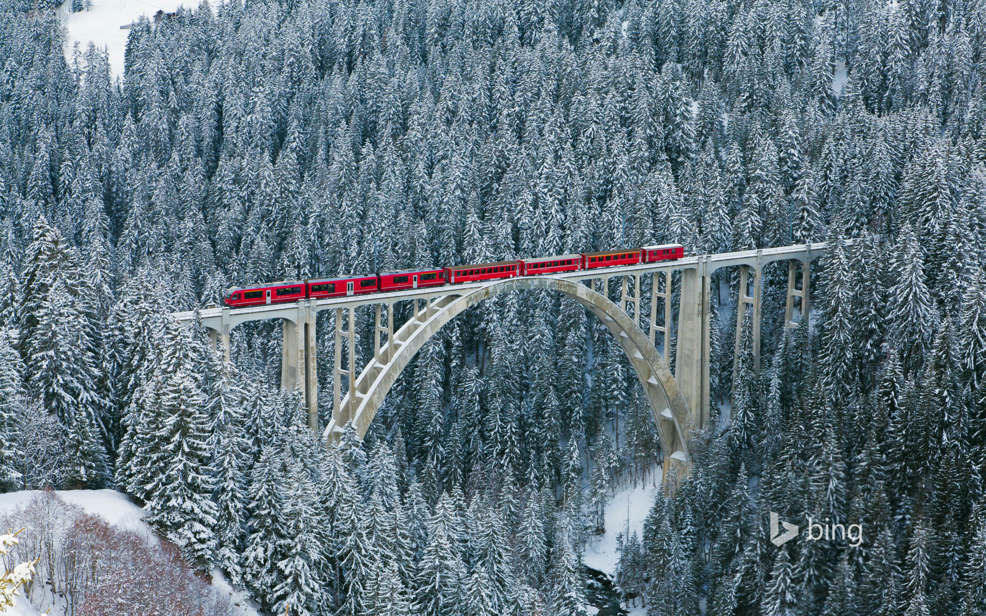 Rhaetian Railway train passing over Langwieser Viaduct, Switzerland