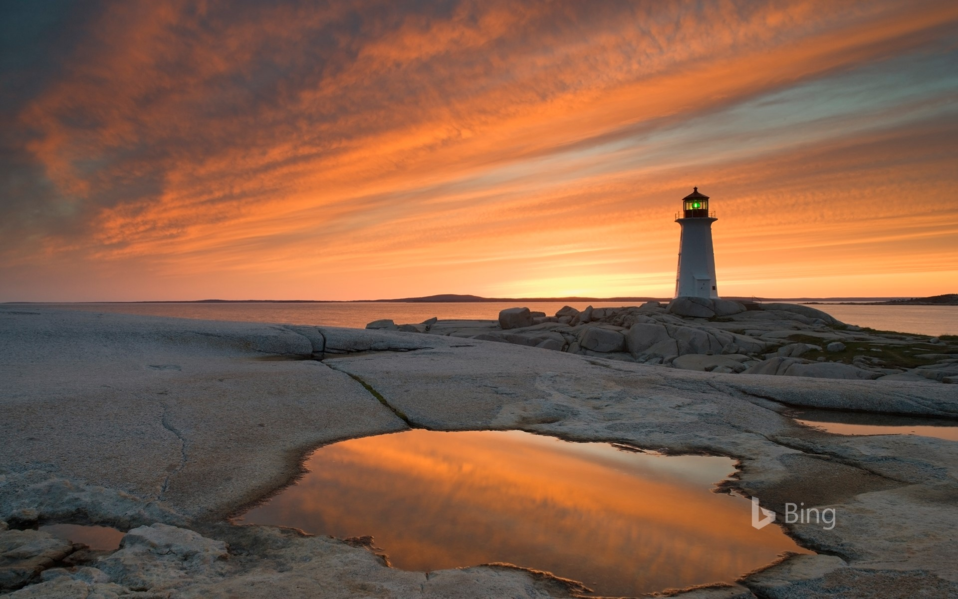 Peggy's Cove Lighthouse at dusk, Nova Scotia, Canada (© Darwin Wiggett/Offset)