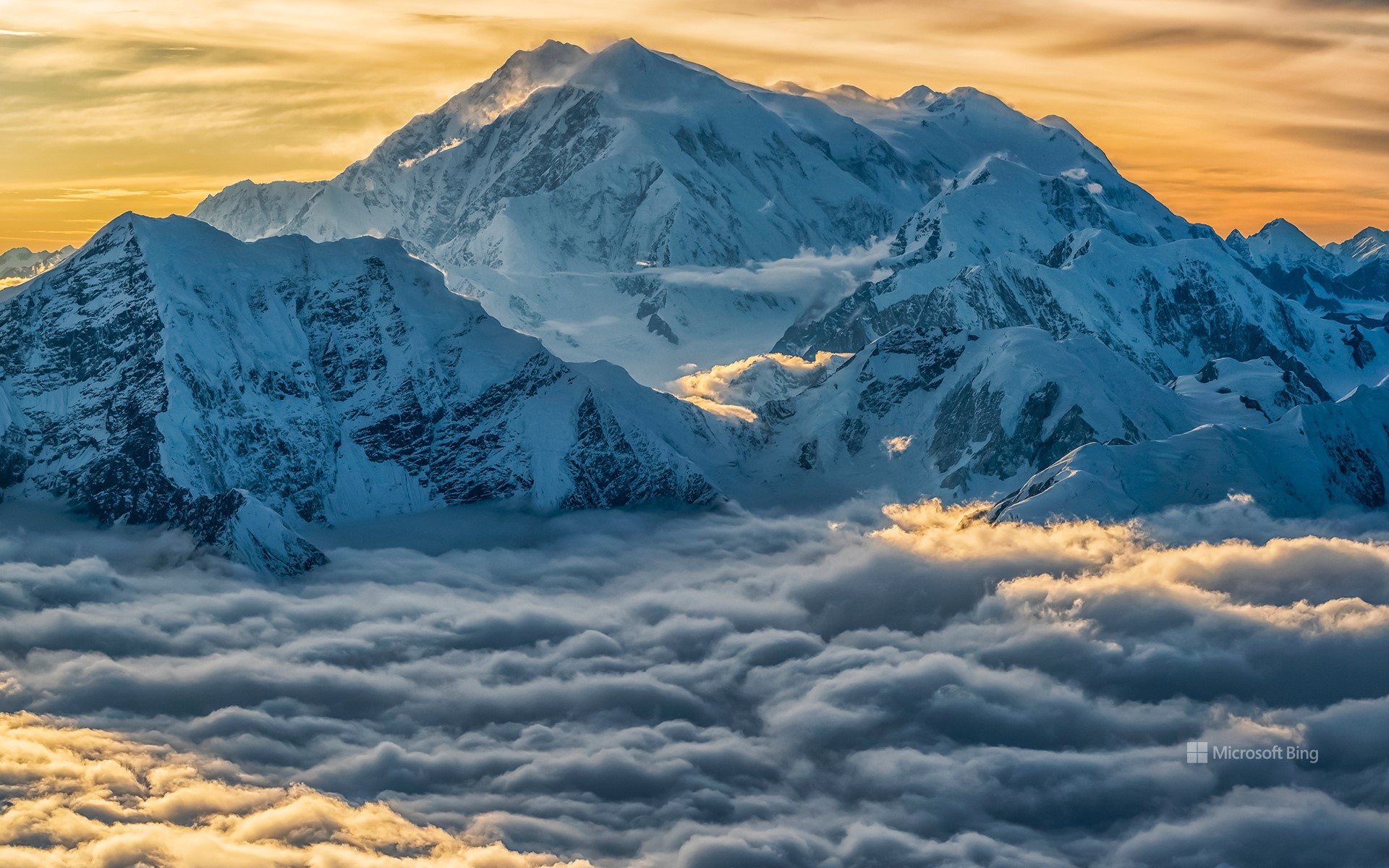 Aerial image of Mount Logan rising above the clouds in Kluane National Park, Yukon