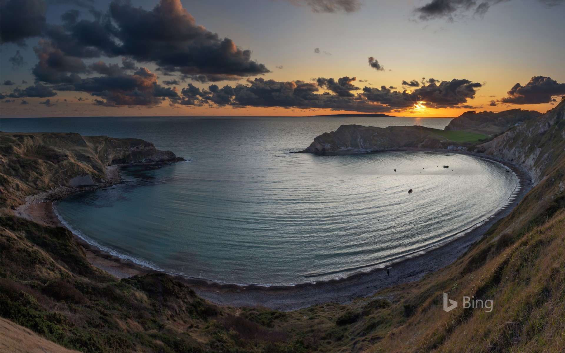 Panoramic view of Lulworth Cove at sunset in Dorset, England