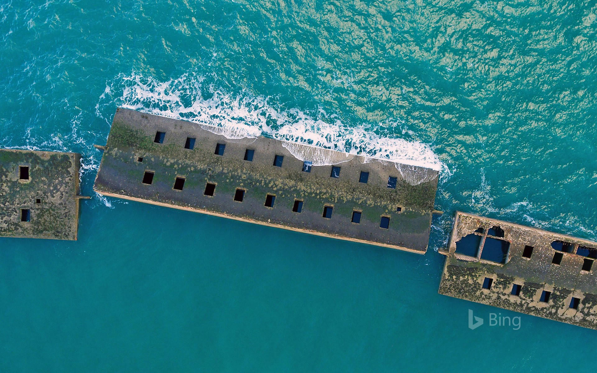 Remains of the Mulberry harbour from the D-Day invasion at Arromanches, Normandy, France