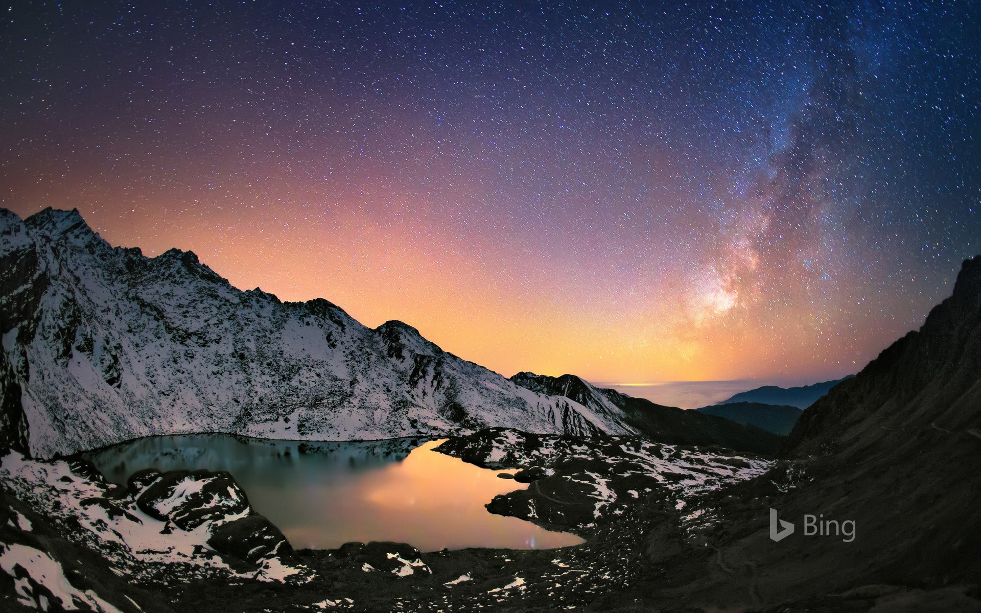 Nepal's Gosaikunda Lake in the Himalayas and the Milky Way above