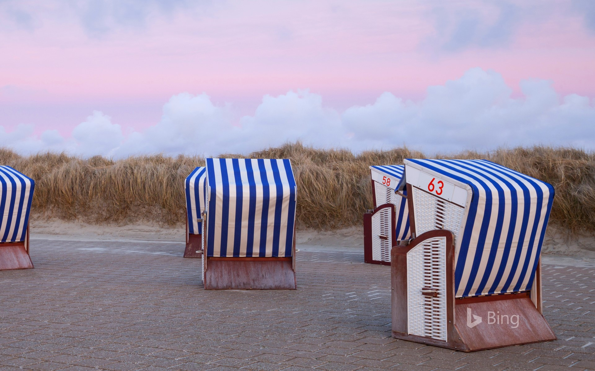 Beach chairs in the sunset on the north beach of the island of Borkum, Lower Saxony