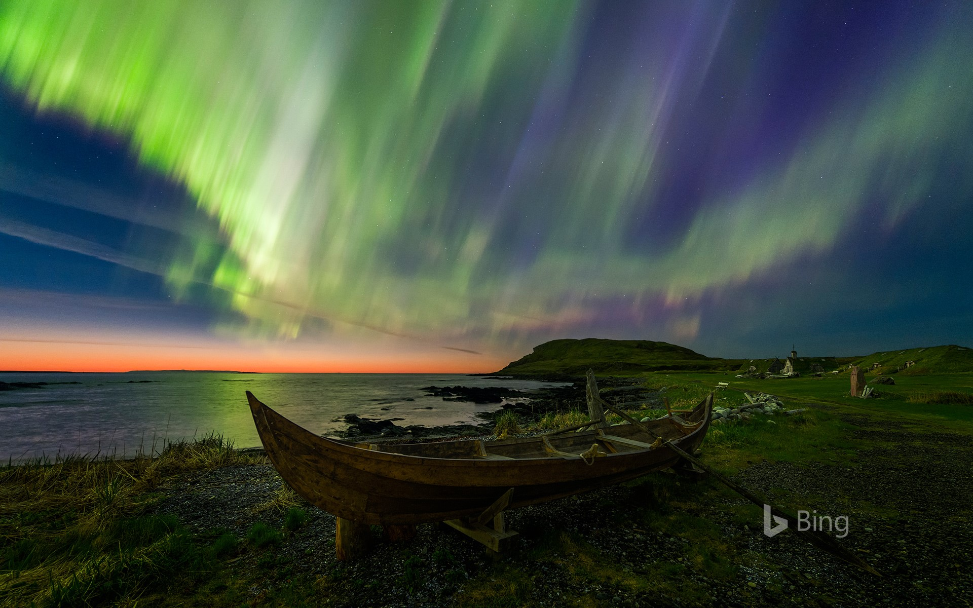 The northern lights over a rowboat in Norstead Viking Village, Newfoundland, Canada