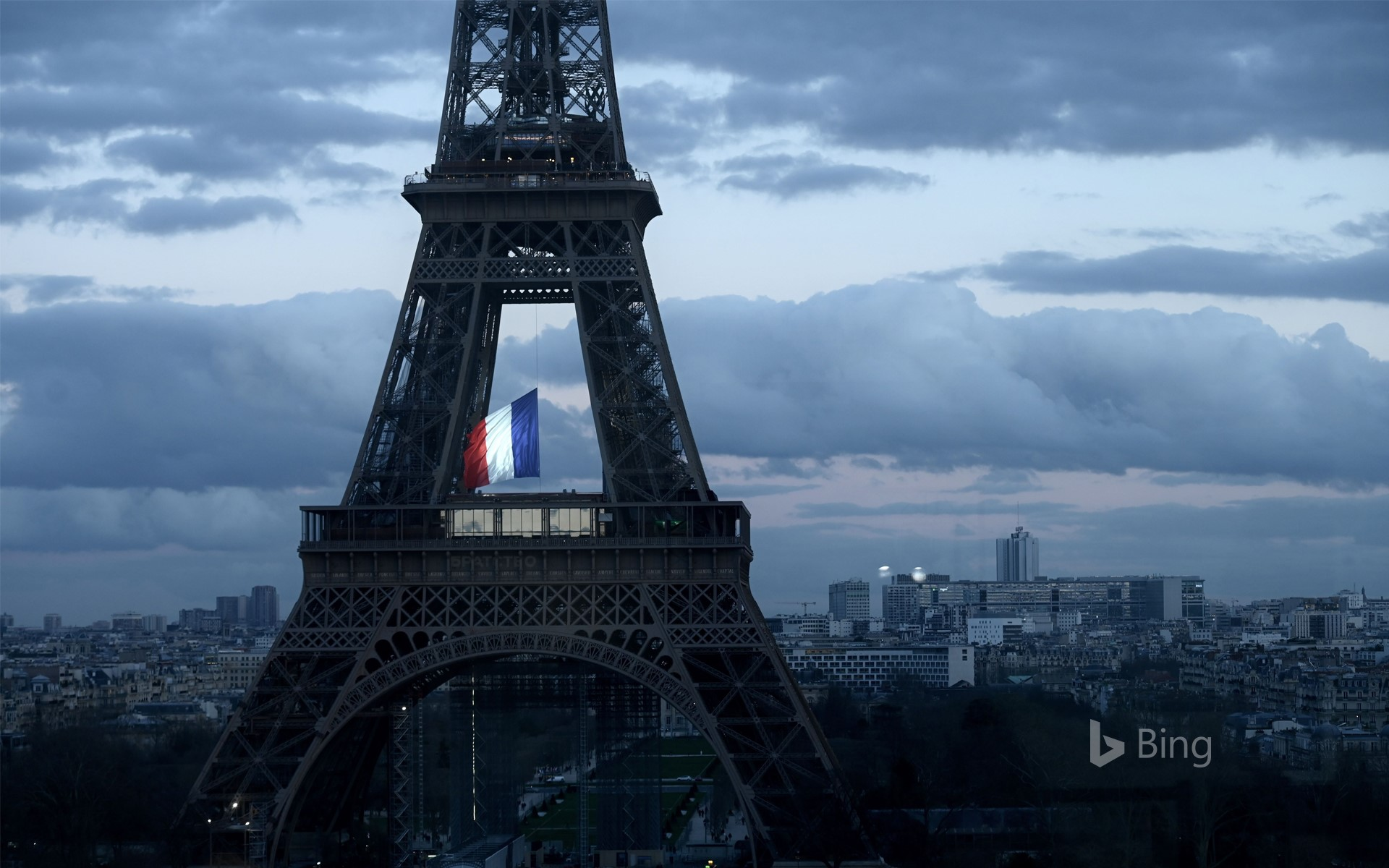 The French flag fluttering in the center of the Eiffel Tower on March 11, 2020, during a ceremony for the first National Day of Homage to Victims of Terrorism