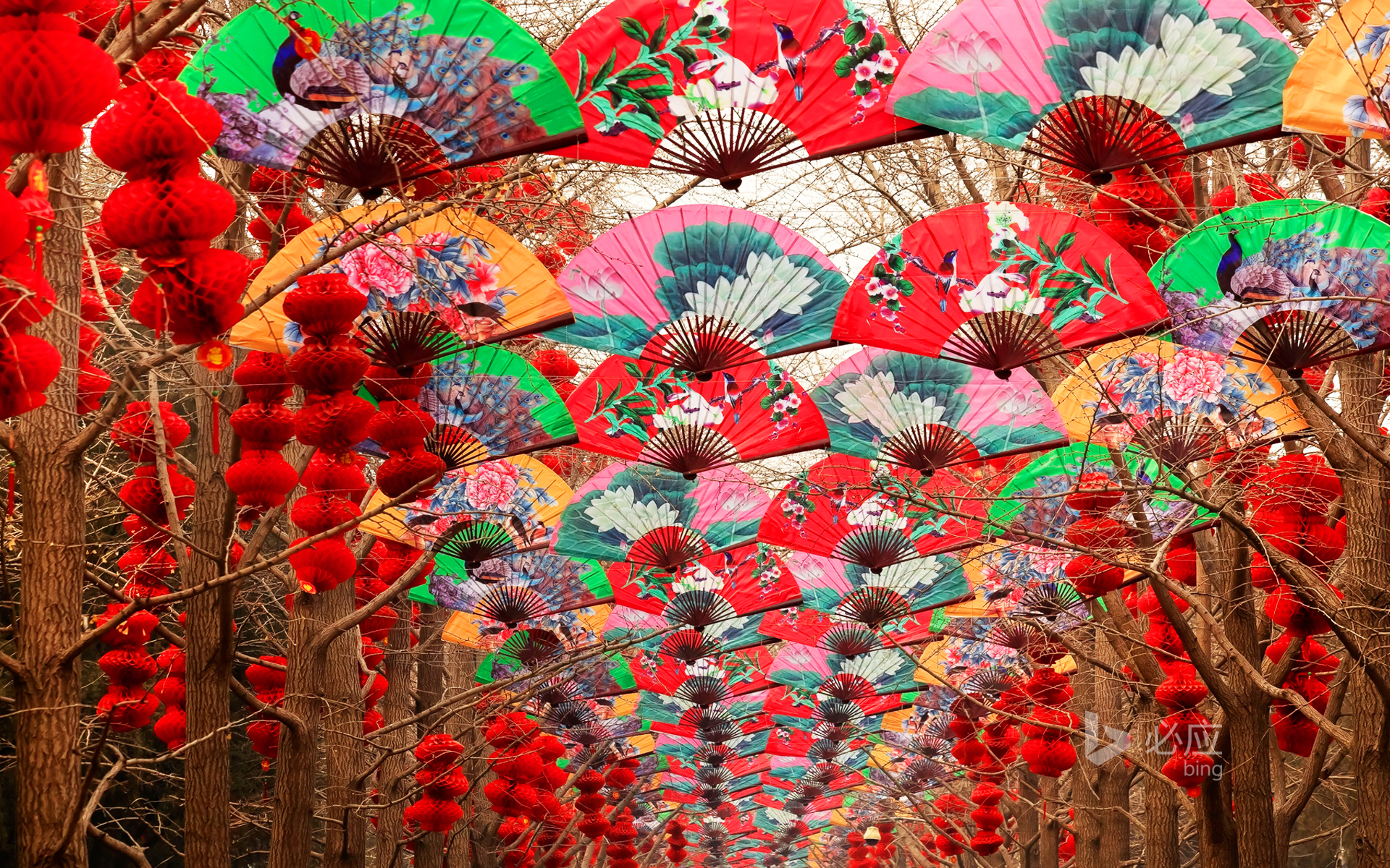 Paper fans and red lanterns during the Spring Festival in Beijing Temple of Heaven