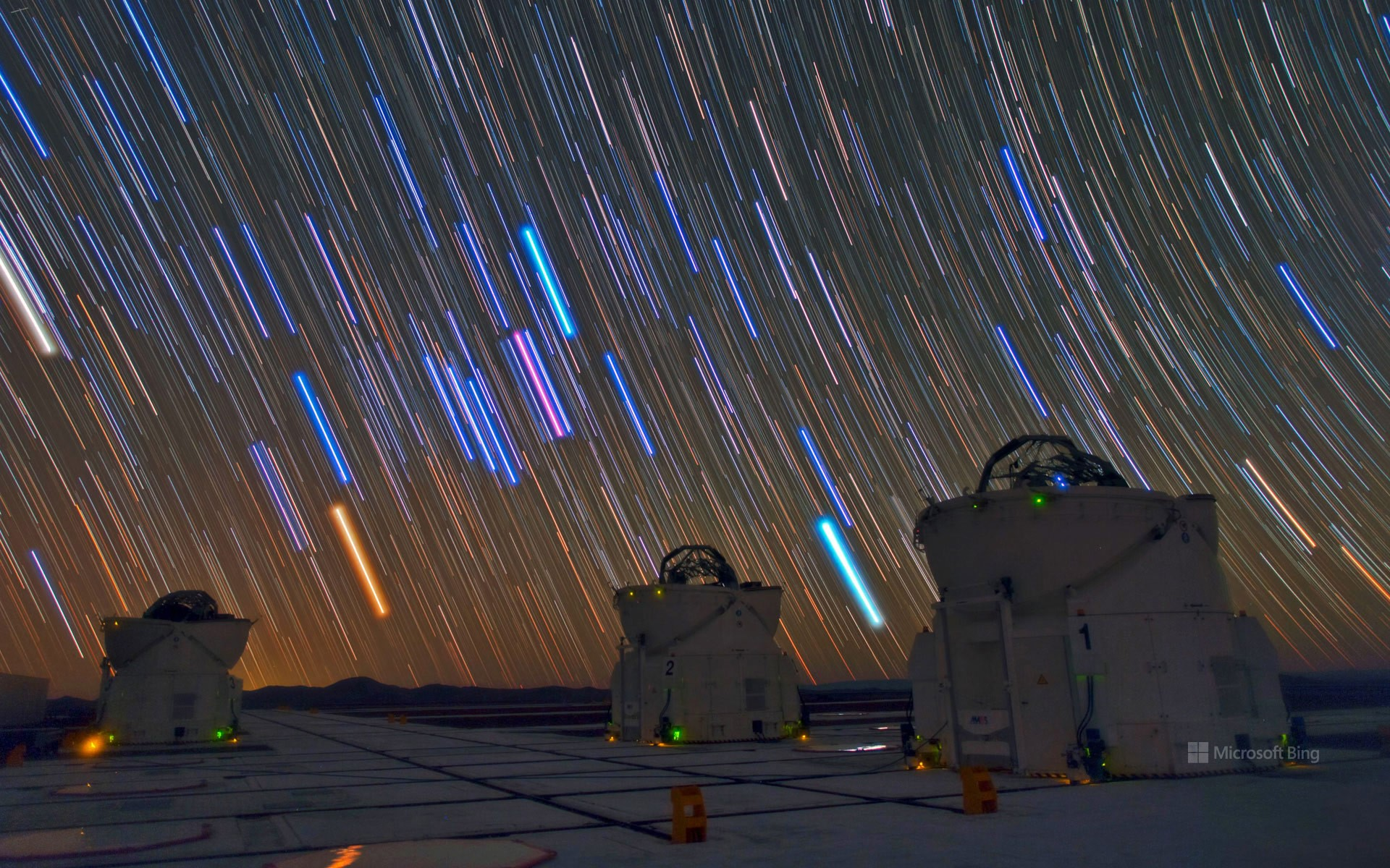 Telescopes and star trails at Paranal Observatory, Atacama Desert, Chile