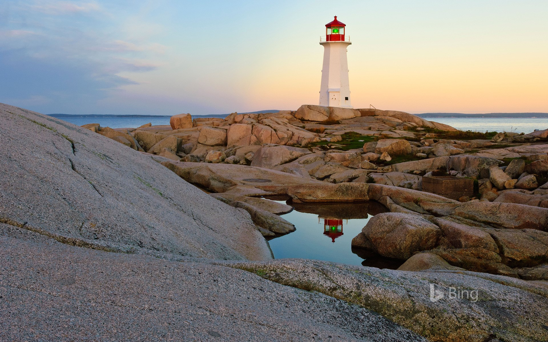 Lighthouse reflected in a pool of water at Peggy's Cove, Nova Scotia, Canada