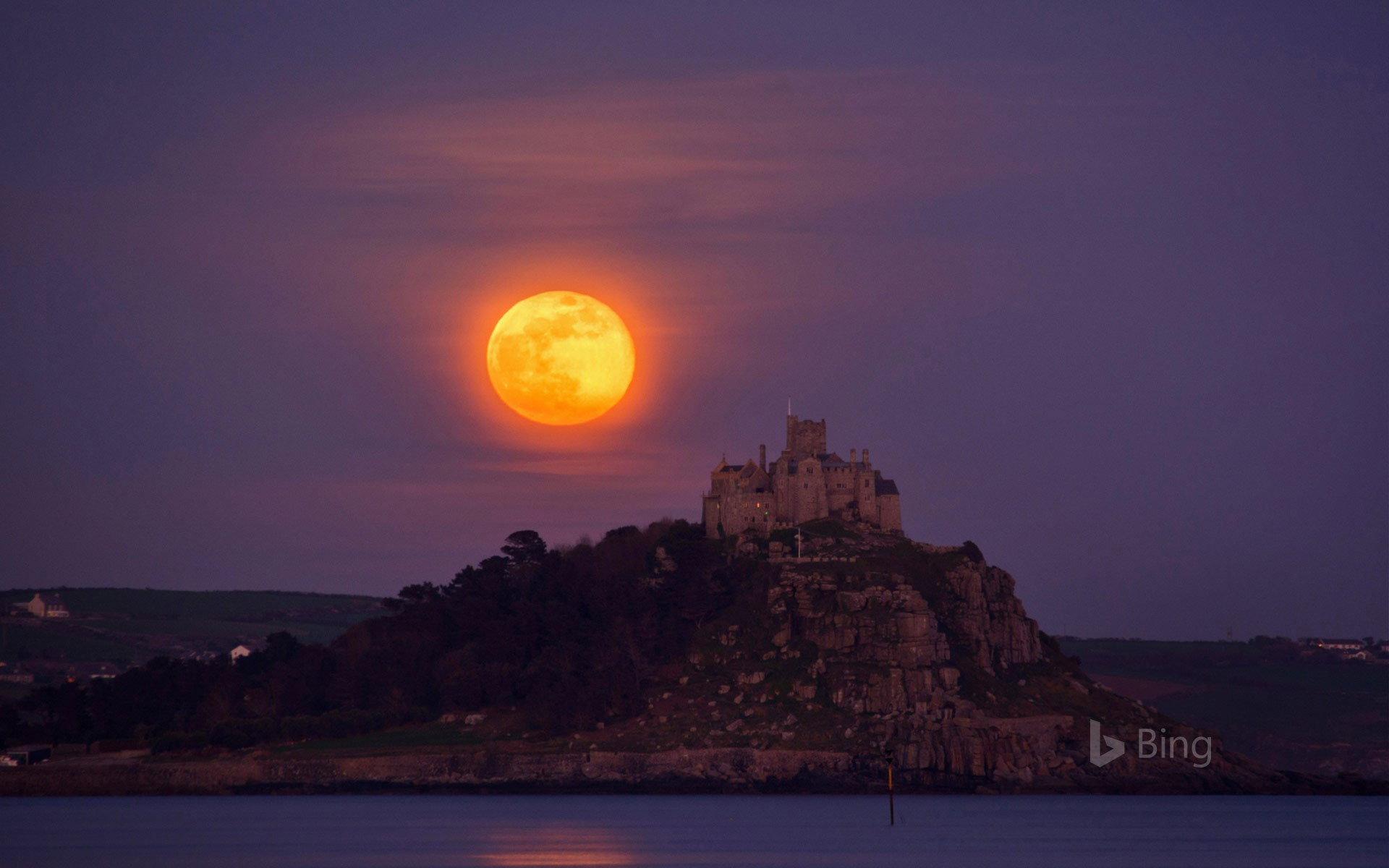 The 2017 April full moon, or pink moon, rises over St. Michael's Mount, Cornwall, England