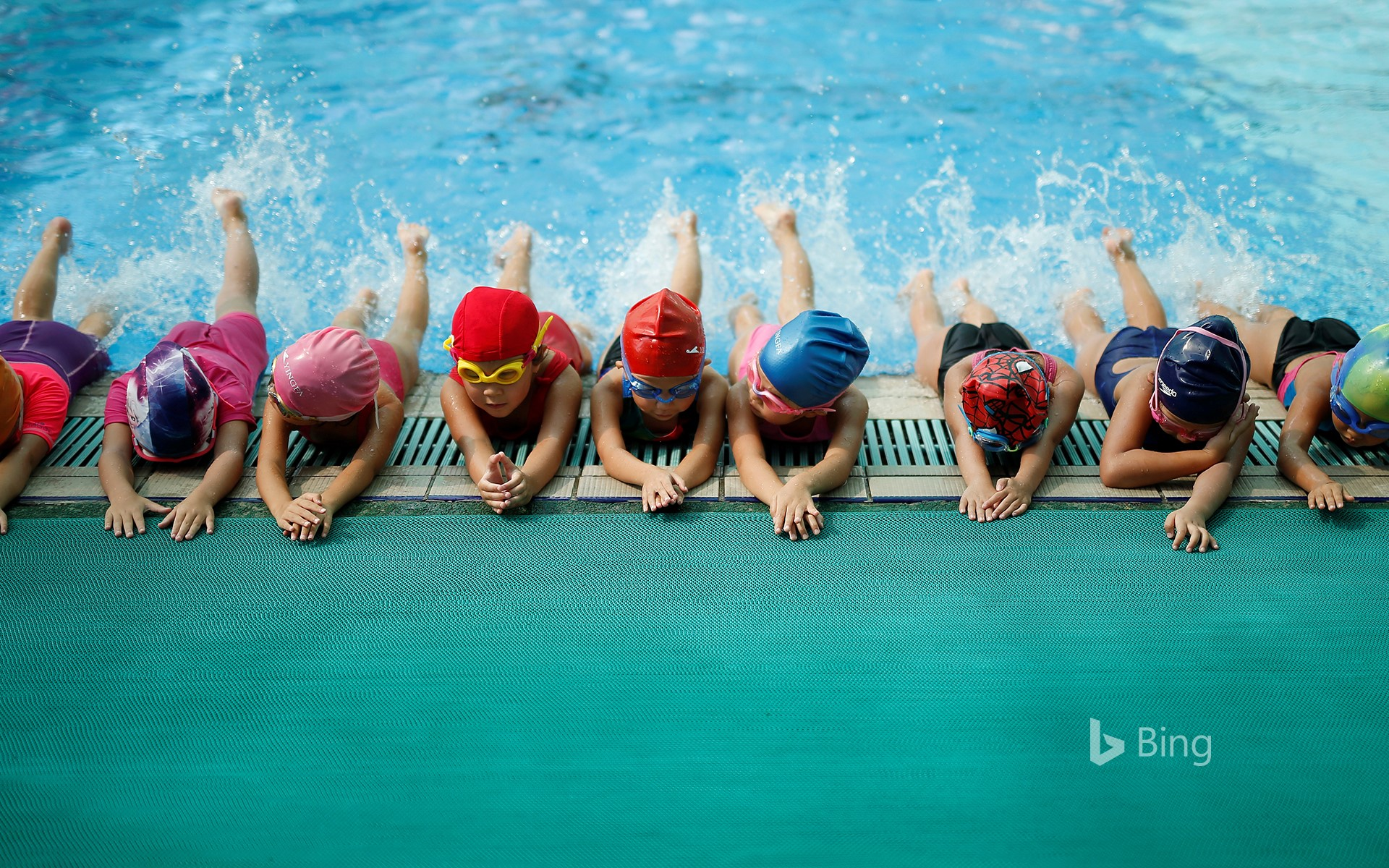 Children are participating in swimming training in the gym of Chen Jinglun Sports School, Hangzhou, China