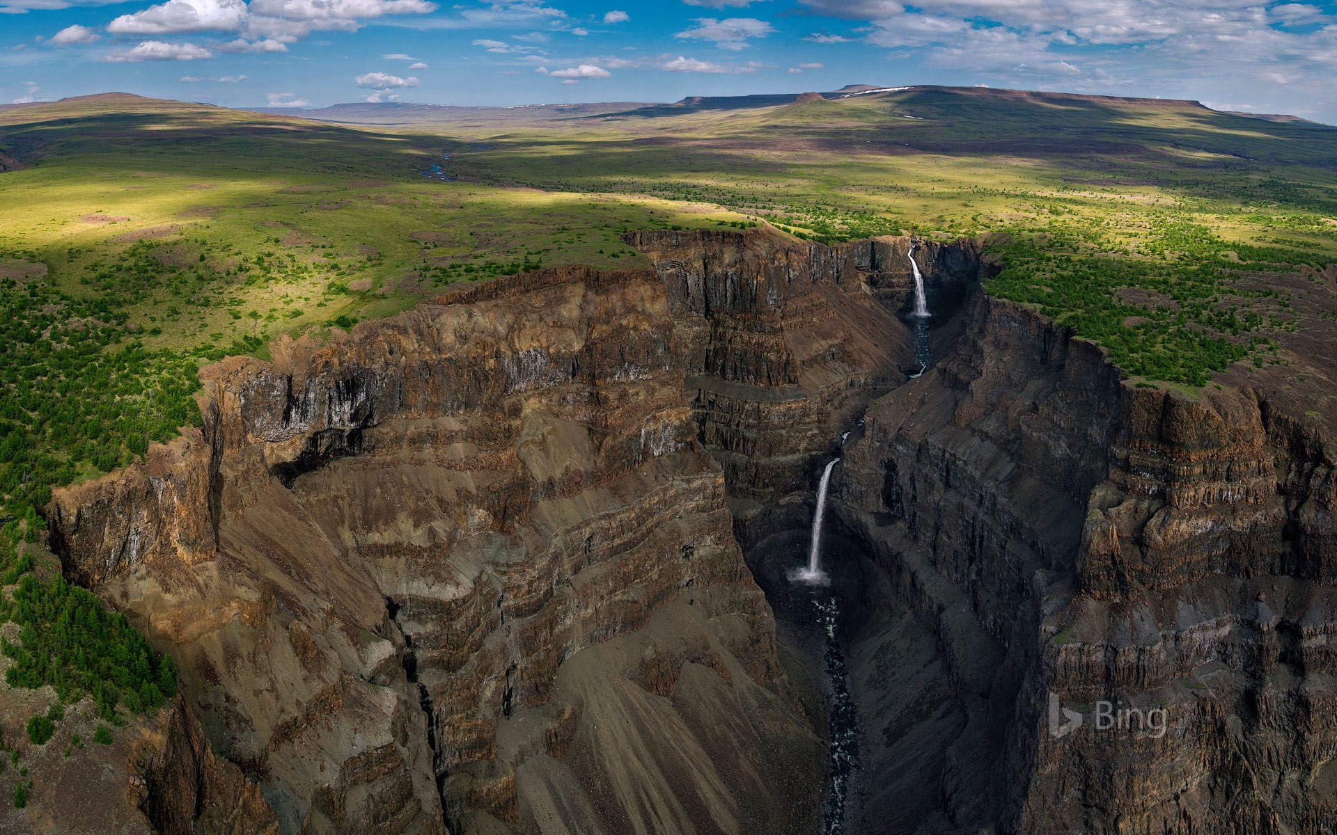 Waterfalls in a canyon of Siberia's Putorana Plateau, Russia