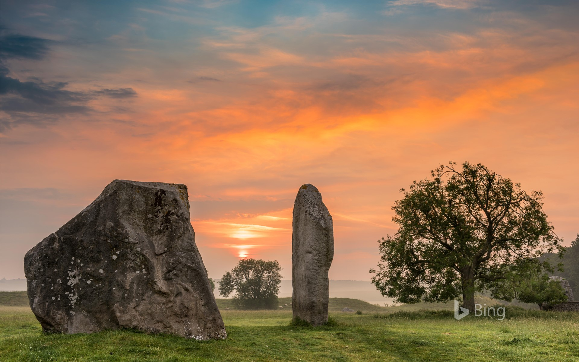 Dawn breaks over the ancient Sarsen Stones at Avebury, Wiltshire, at Summer Solstice