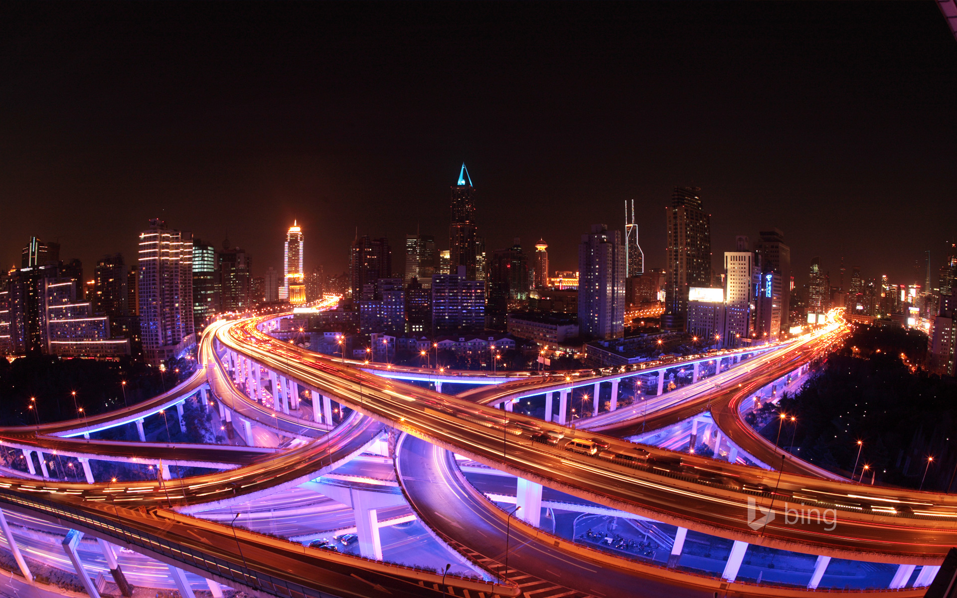Shanghai 39 s roadways and skyline lit up at night kevin lee getty images bing wallpapers - Shanghai skyline wallpaper ...