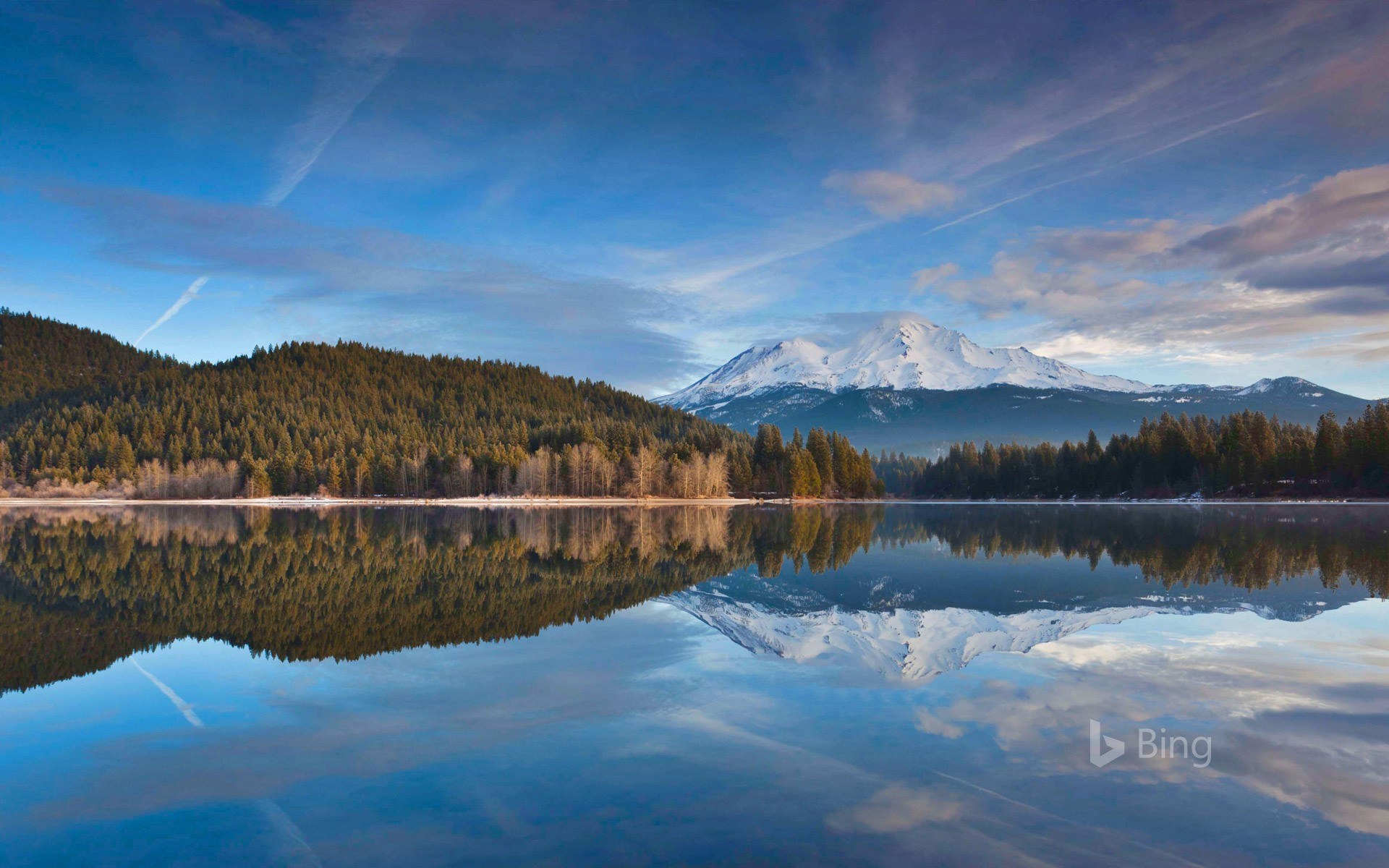 Lake Siskiyou reflects snowy Mount Shasta in northern California