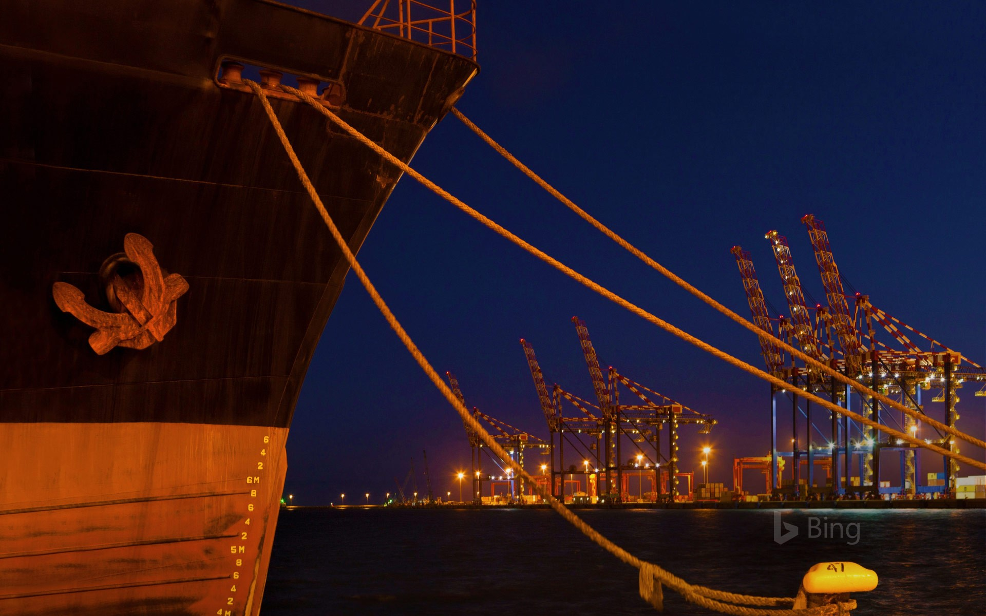 A ship docked at night in the Port of Cape Town, South Africa