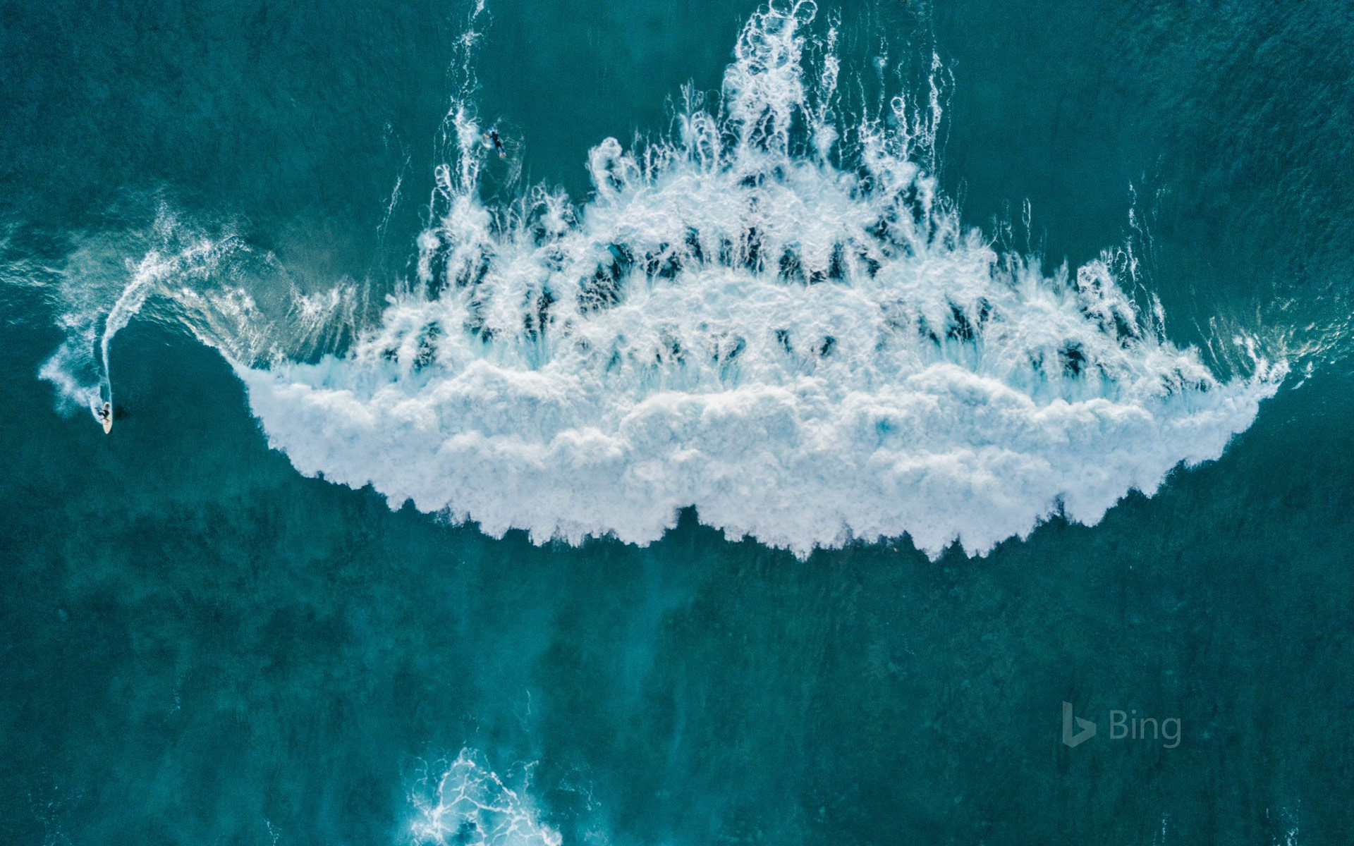 Aerial view of surfer catching a wave, Tenerife, Canary Islands, Spain