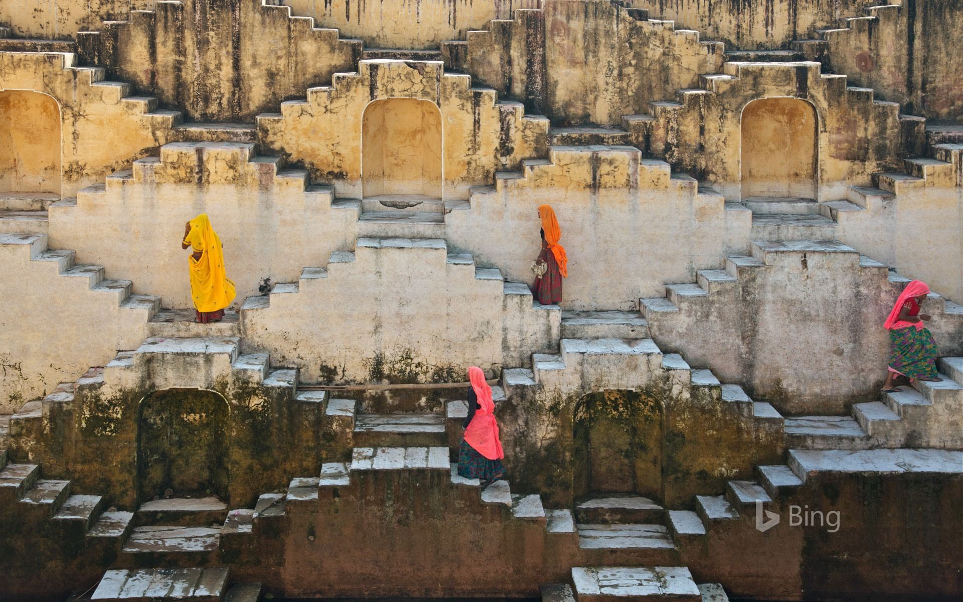 Women climbing a stepwell near Amber Fort in Jaipur, Rajasthan, India