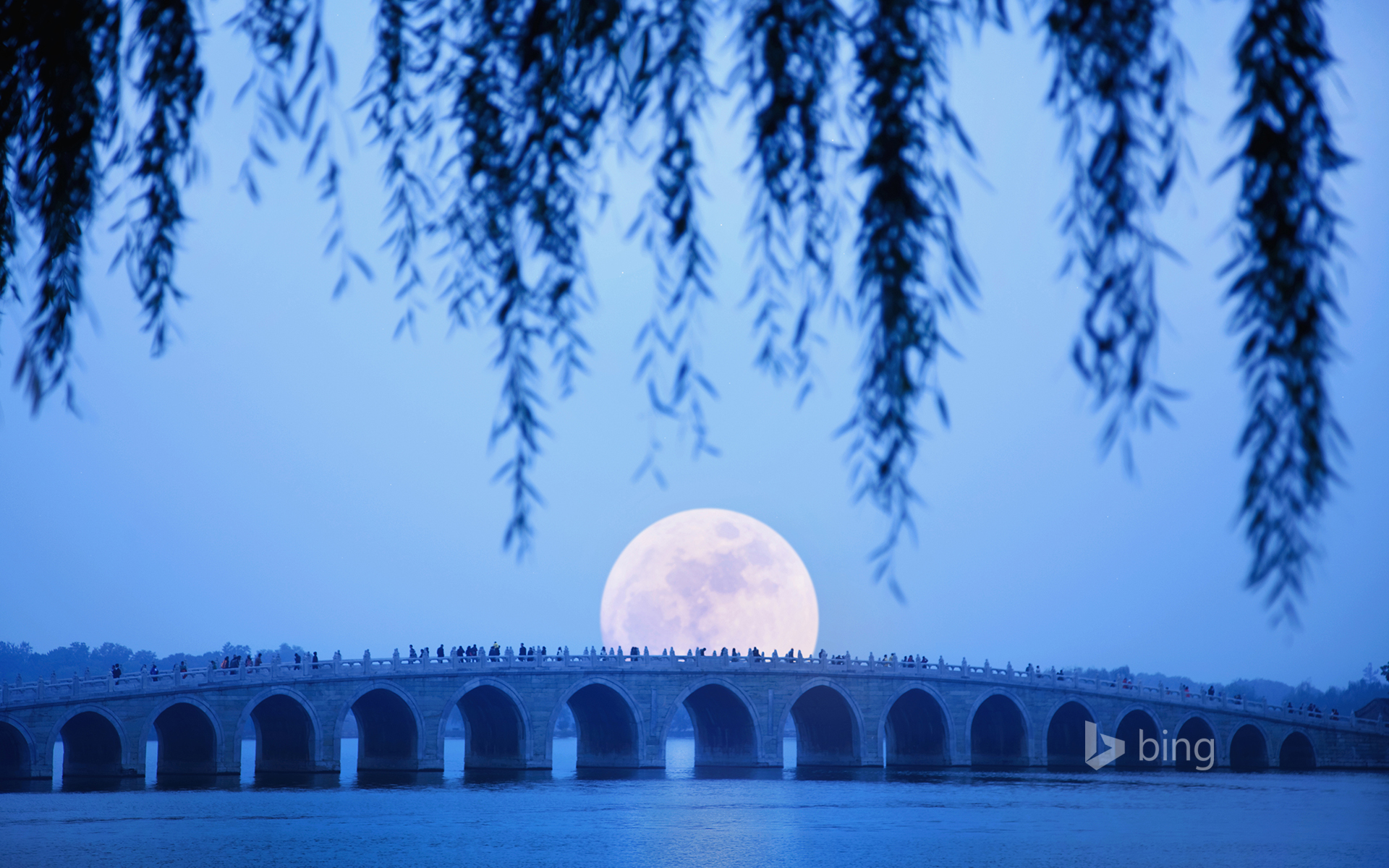 Moonrise over Seventeen Arch Bridge on Kunming Lake at the Summer Palace in Beijing, China