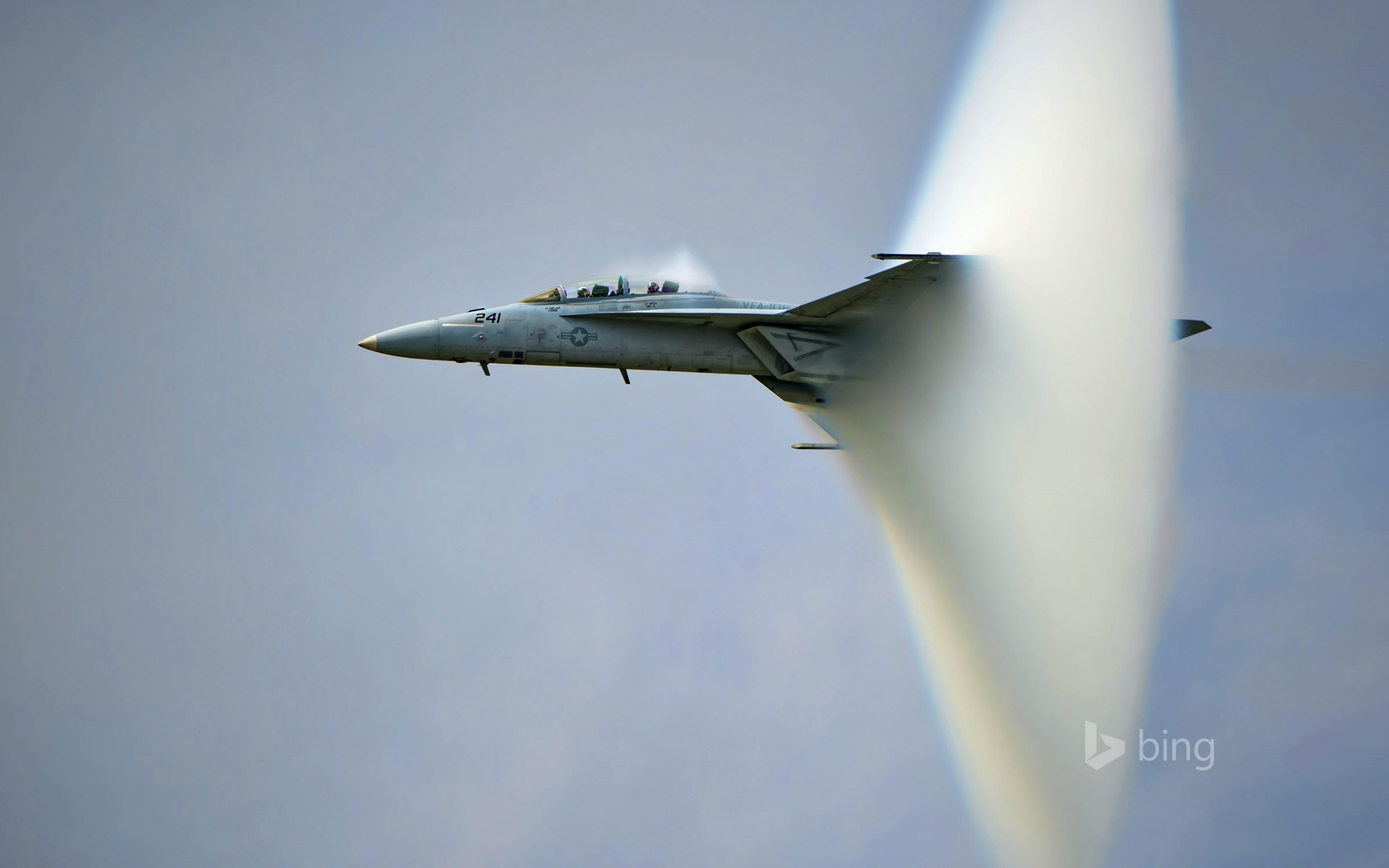 US Navy F/A-18F Super Hornet creating a sonic boom