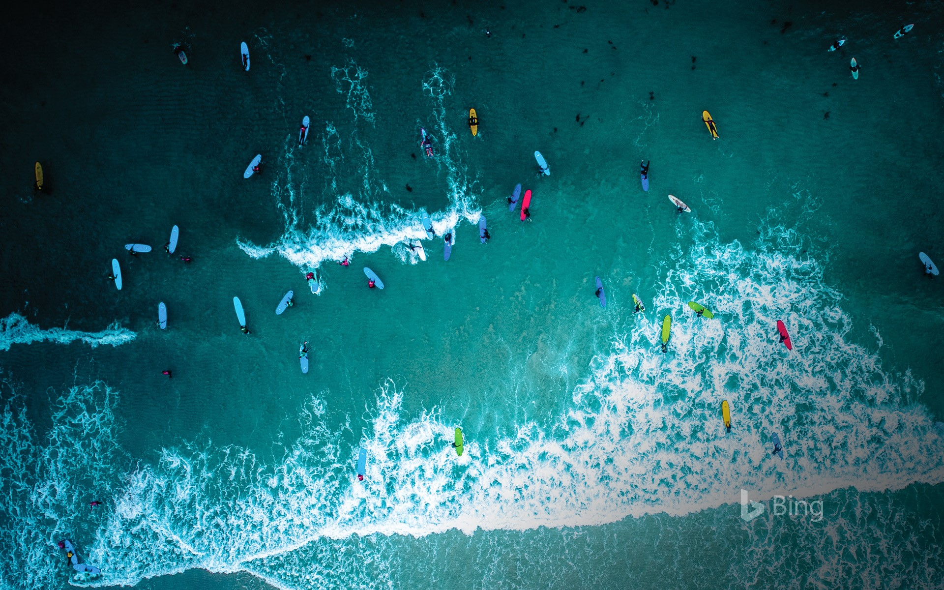 Aerial view of surfers in Cornwall for International Surfing Day