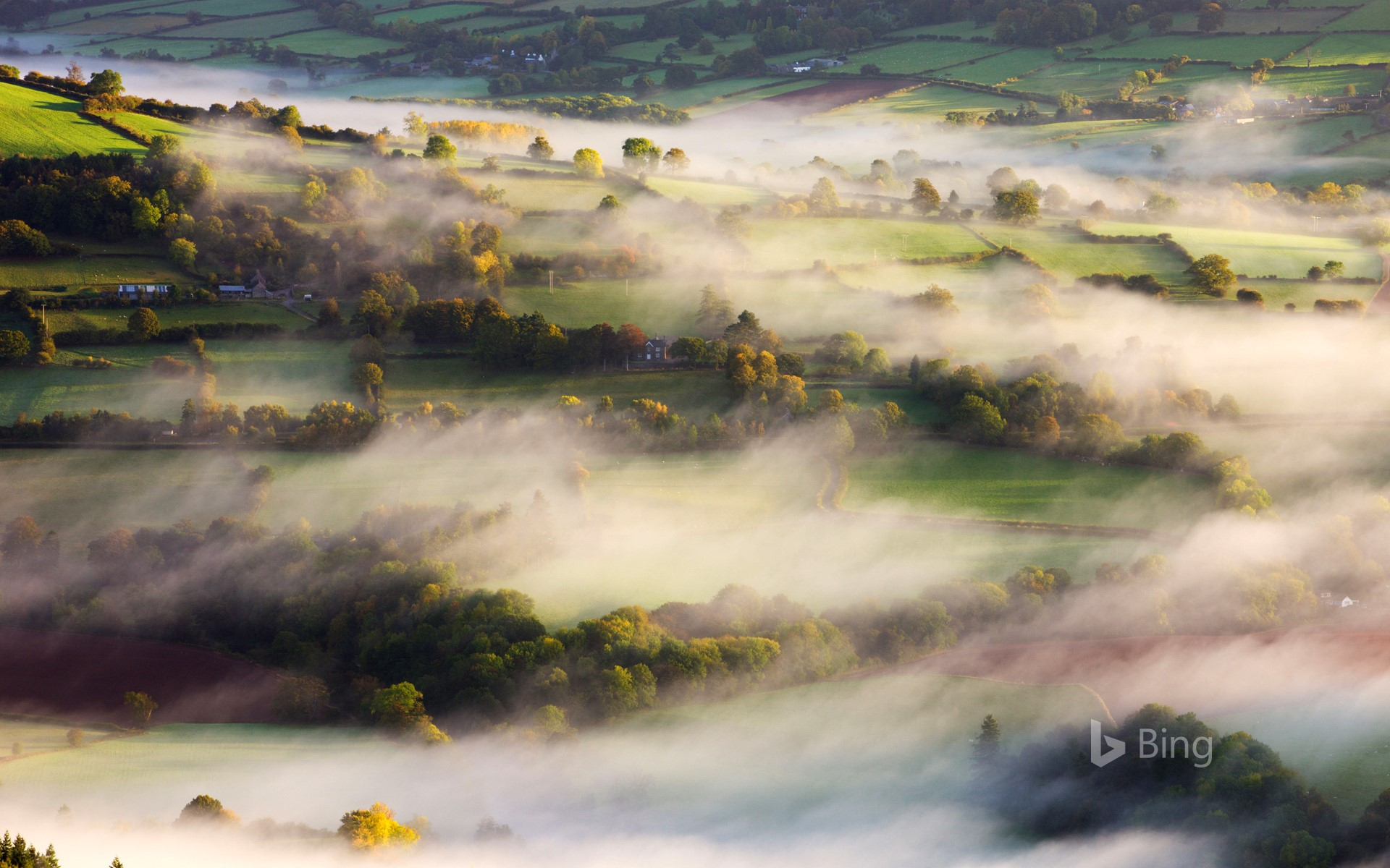 Mist blows over rolling countryside near Talybont-on-Usk in Brecon Beacons National Park, Wales