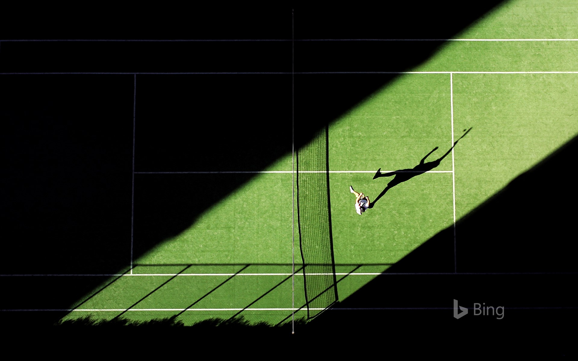 An aerial shot of a tennis match for the opening day of the 2019 Wimbledon Championships