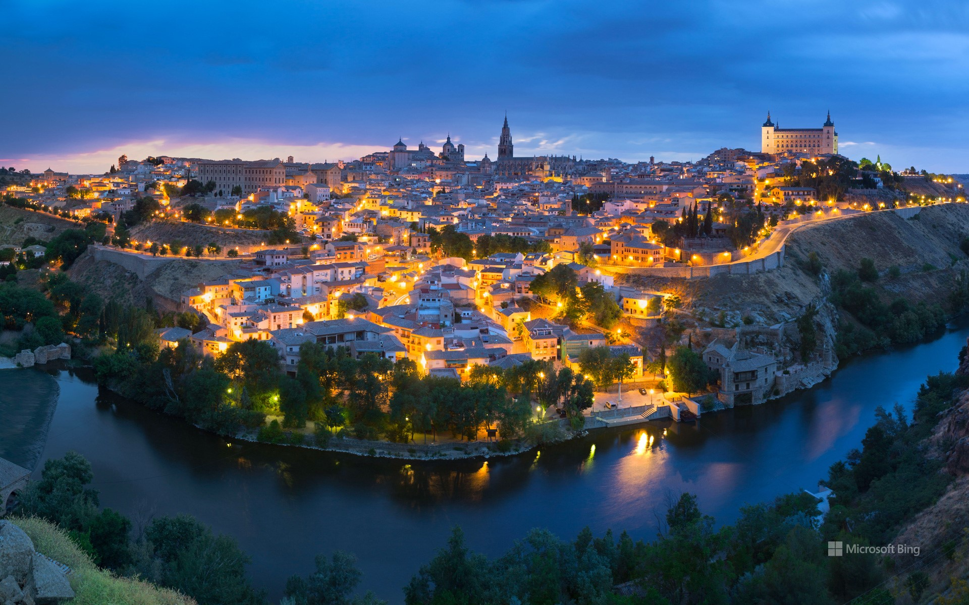 Panoramic view of the city of Toledo after sunset, Spain