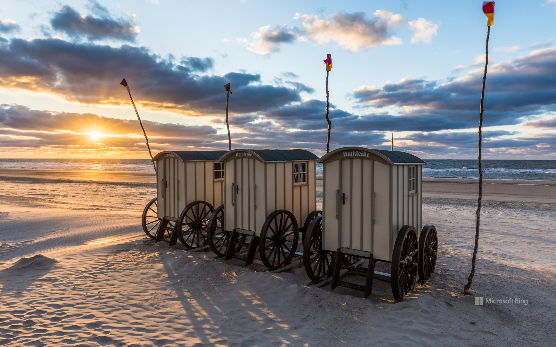 Changing cars on the beach at sunset on the island of Norderney, East Frisia, Lower Saxony